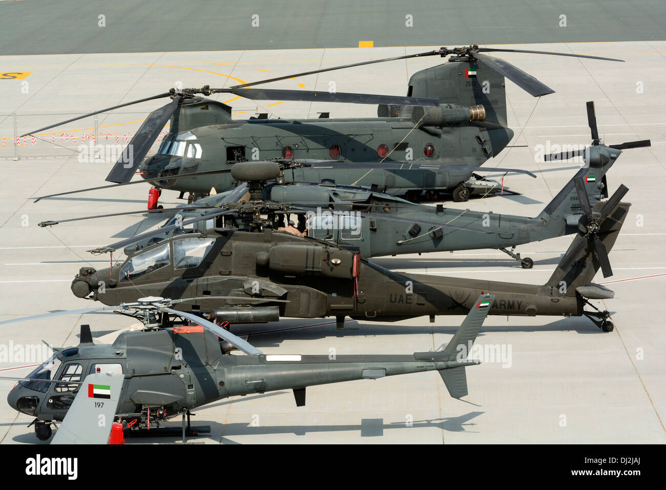Military helicopters on apron at Al Maktoum International airport during Dubai Airshow 2013 in United Arab Emirates - Stock Image