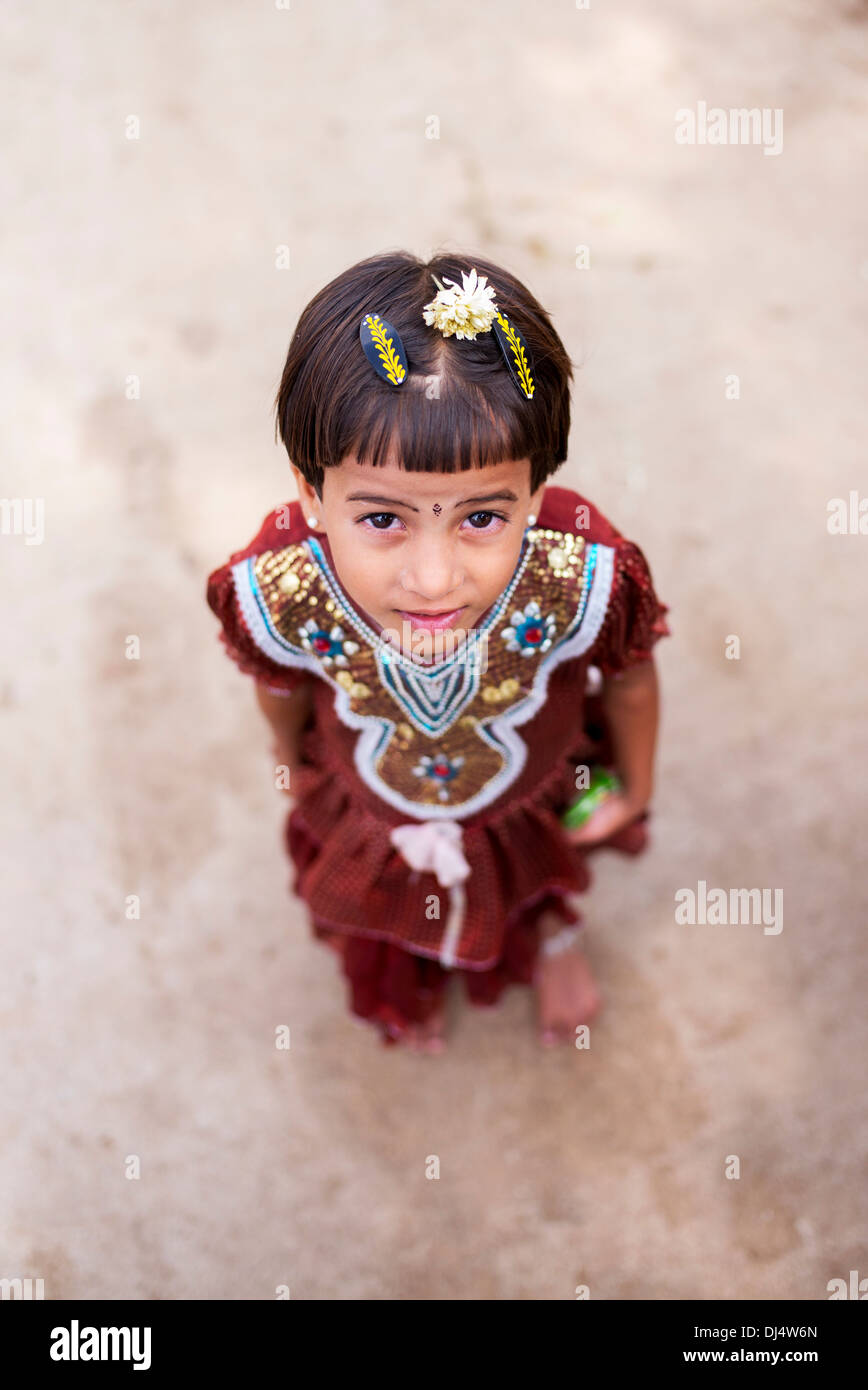 Young Indian girl in the street in a rural Indian village. Andhra Pradesh, India. Selective focus - Stock Image