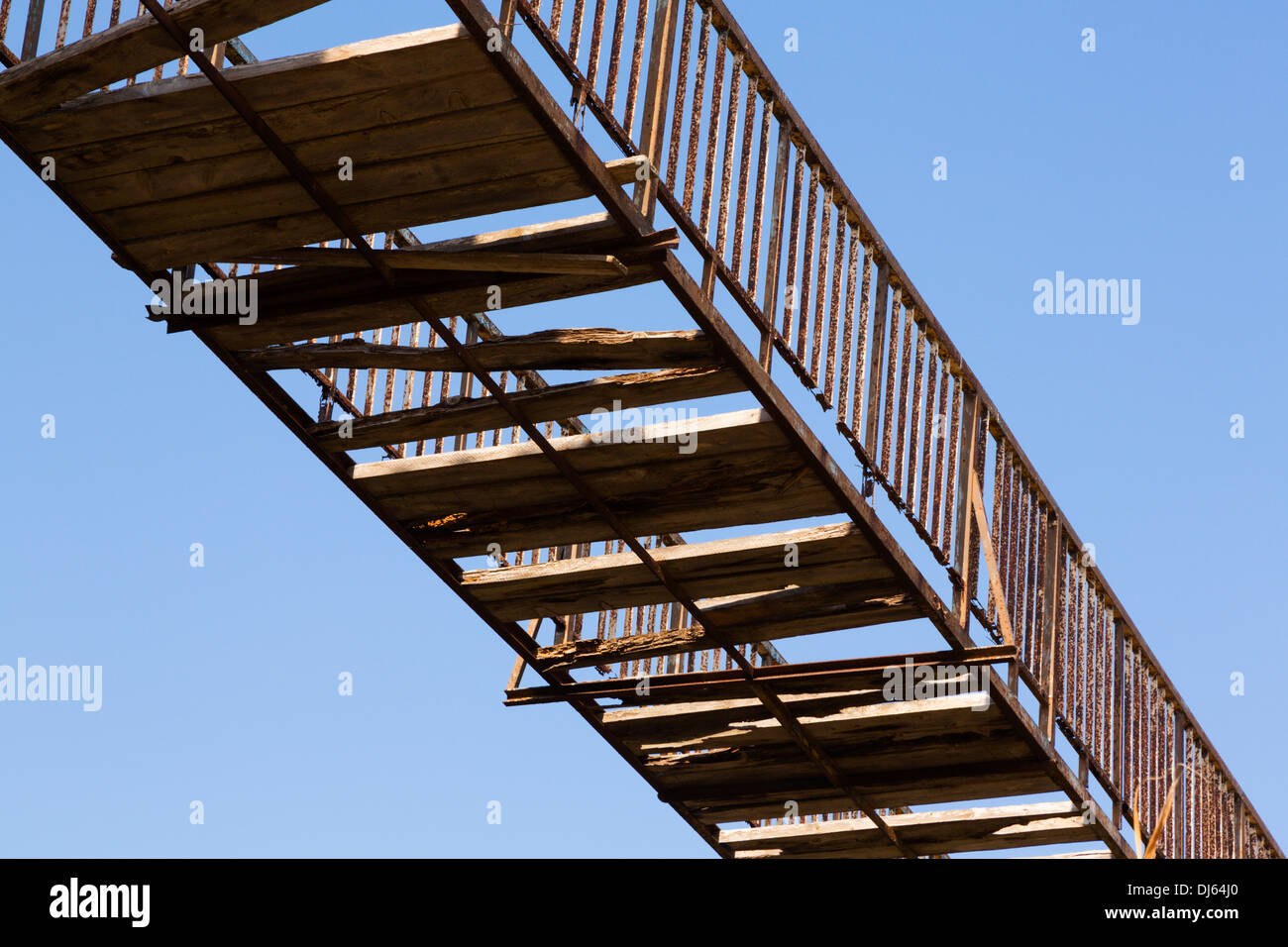 broken-footbridge-against-a-blue-sky-pot