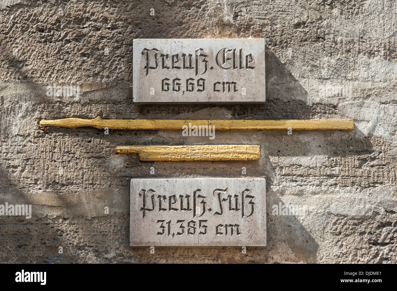 Historical measures of length at the Town Hall, gilded with explanatory panels, Bad Langensalza, Thuringia, Germany - Stock Image