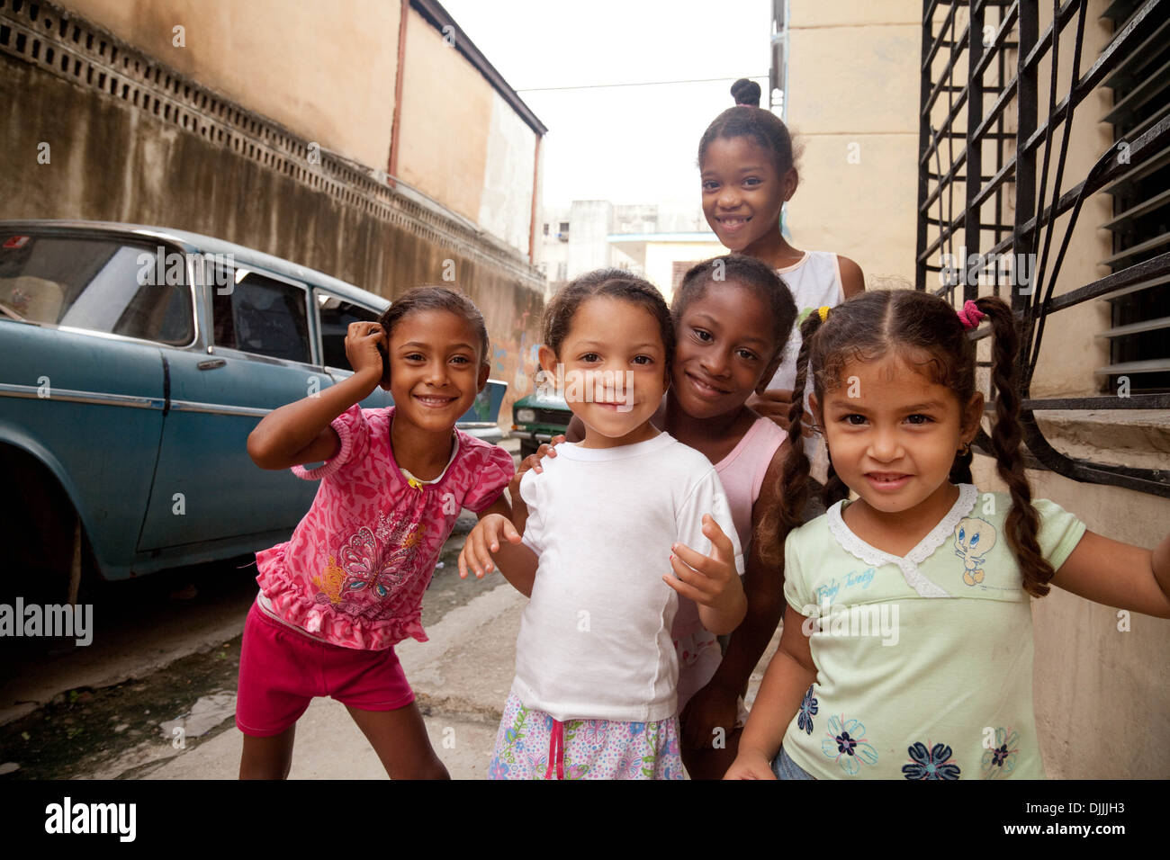 cuba-children-happy-cuban-children-playing-on-the-street-in-a-poor-DJJJH3.jpg