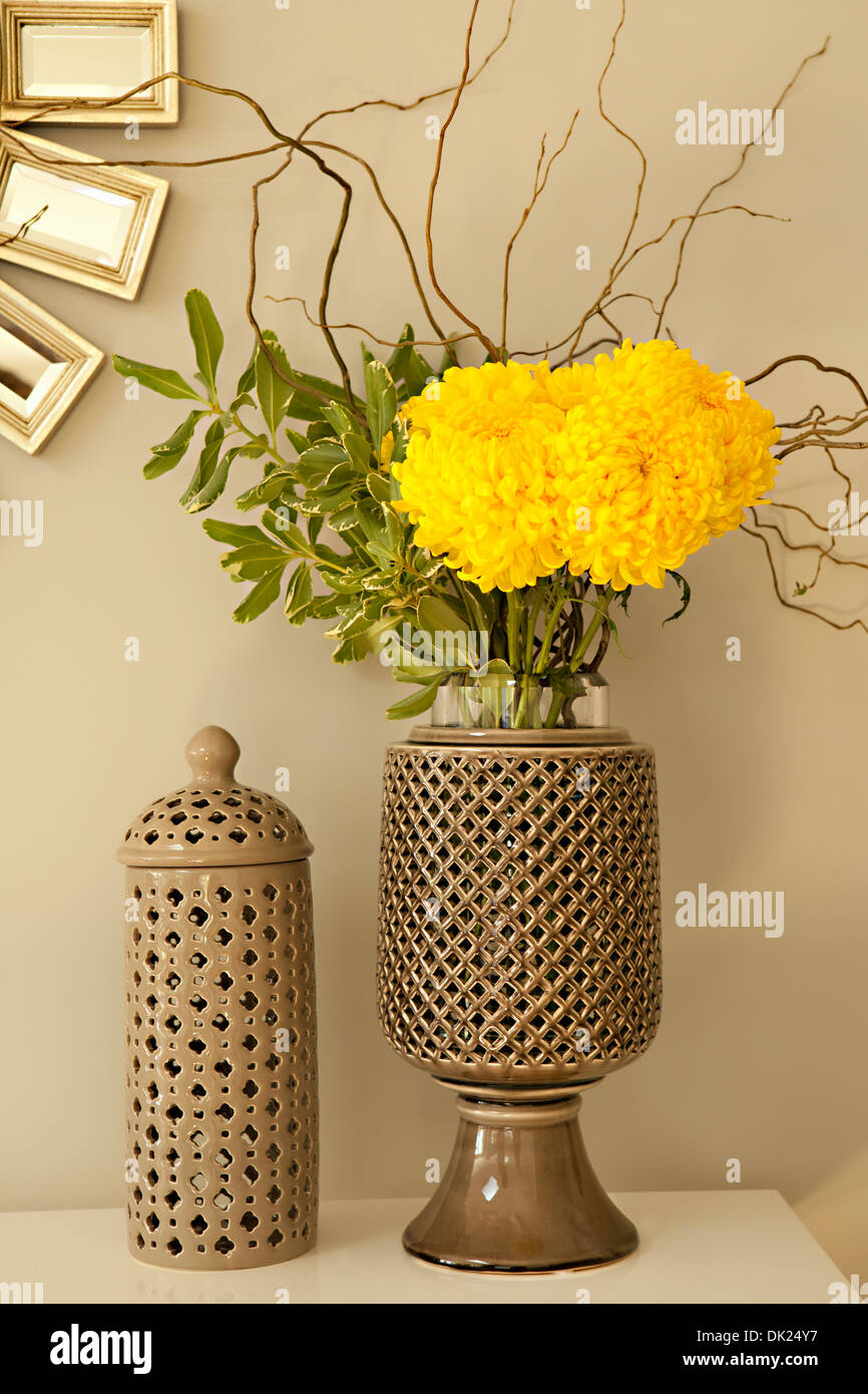 Close up of yellow mums flower arrangement in ceramic vase - Stock Image