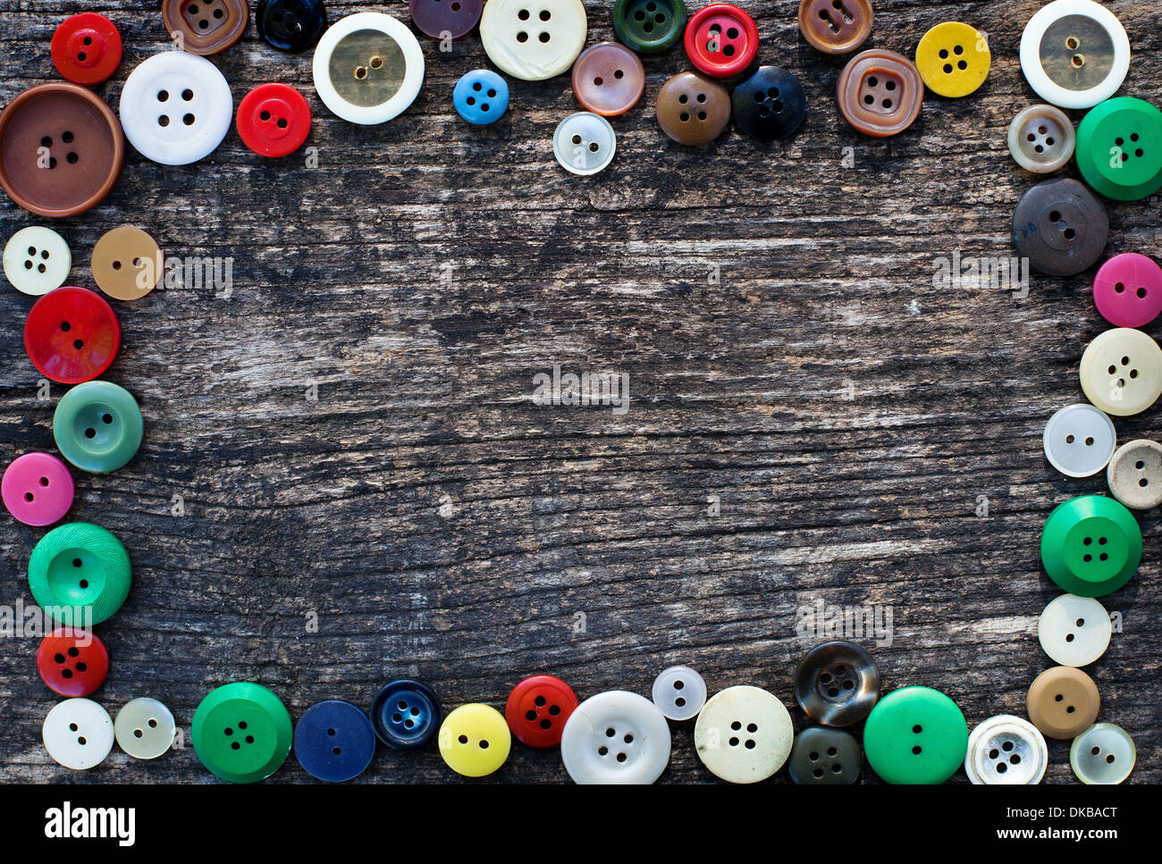 sewing background with frame from buttons - Stock Image