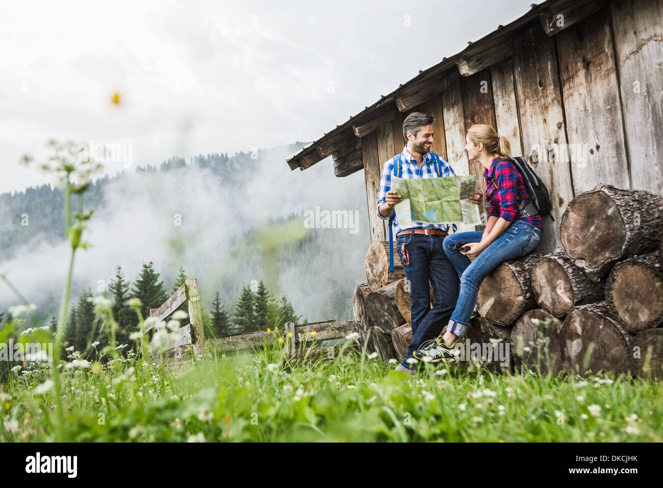 Couple with map discussing their trek, Tirol, Austria - Stock Image