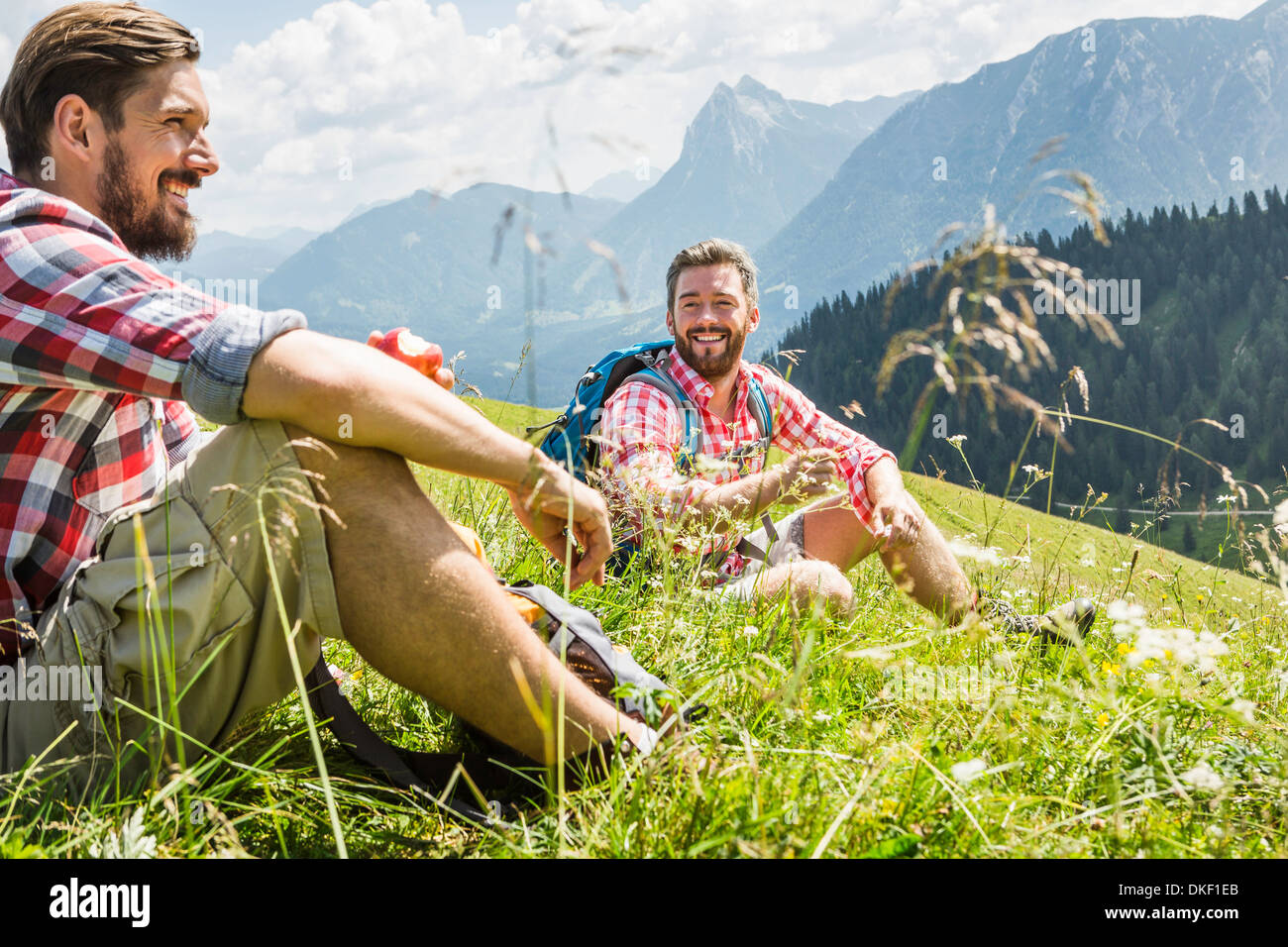 Male friends resting on hike, Tyrol, Austria - Stock Image