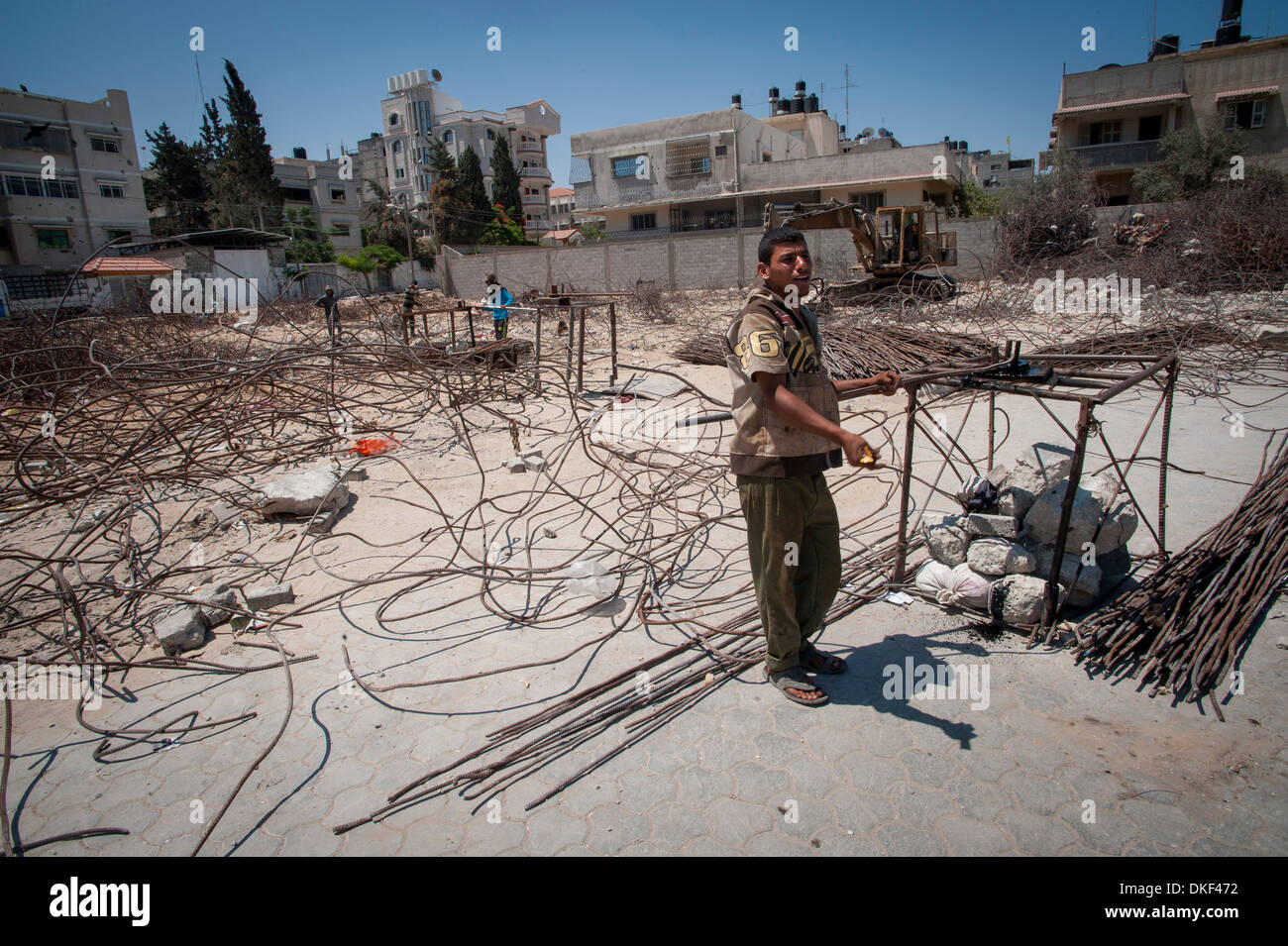 Youths reclaiming metal from Israeli bomb damage to be used again in construction in Gaza City, Gaza, Palestinian - Stock Image
