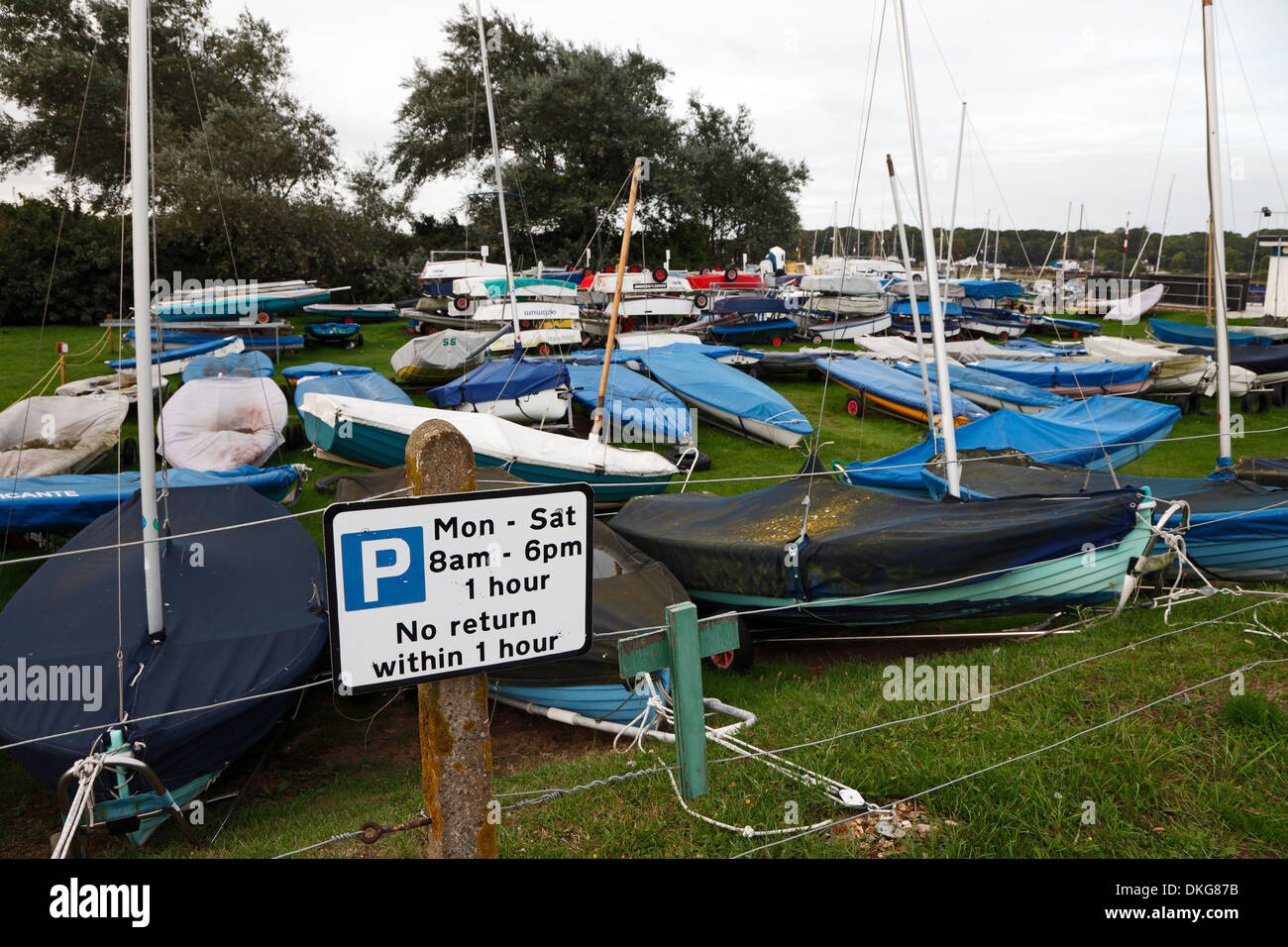 parking-sign-in-front-of-small-sail-boat