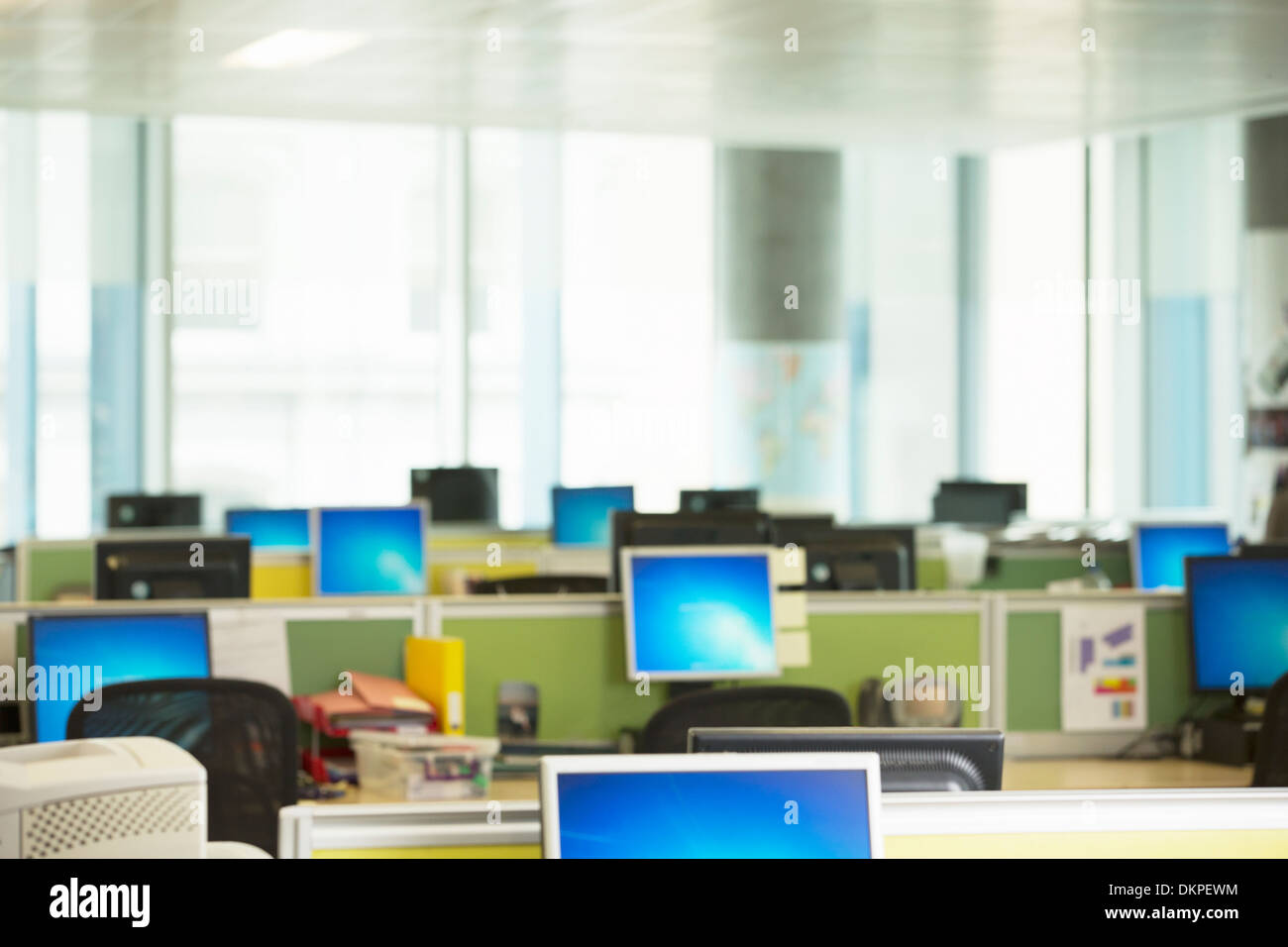 Computers in empty office - Stock Image