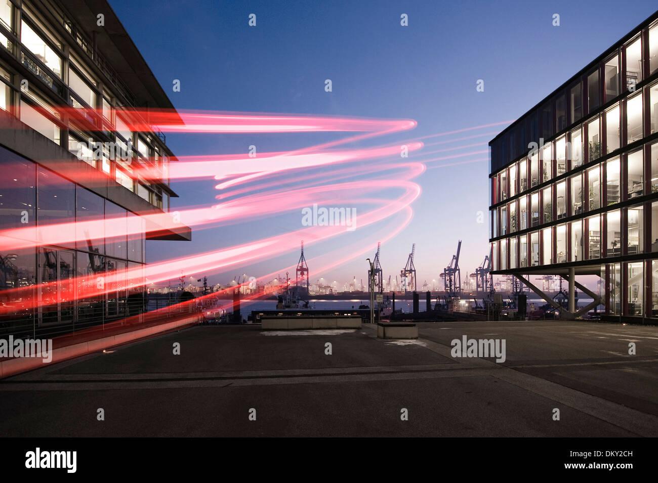 Neumühlen, modern office buildings, harbor cranes in the evening, Hamburg, Germany, Europe - Stock Image