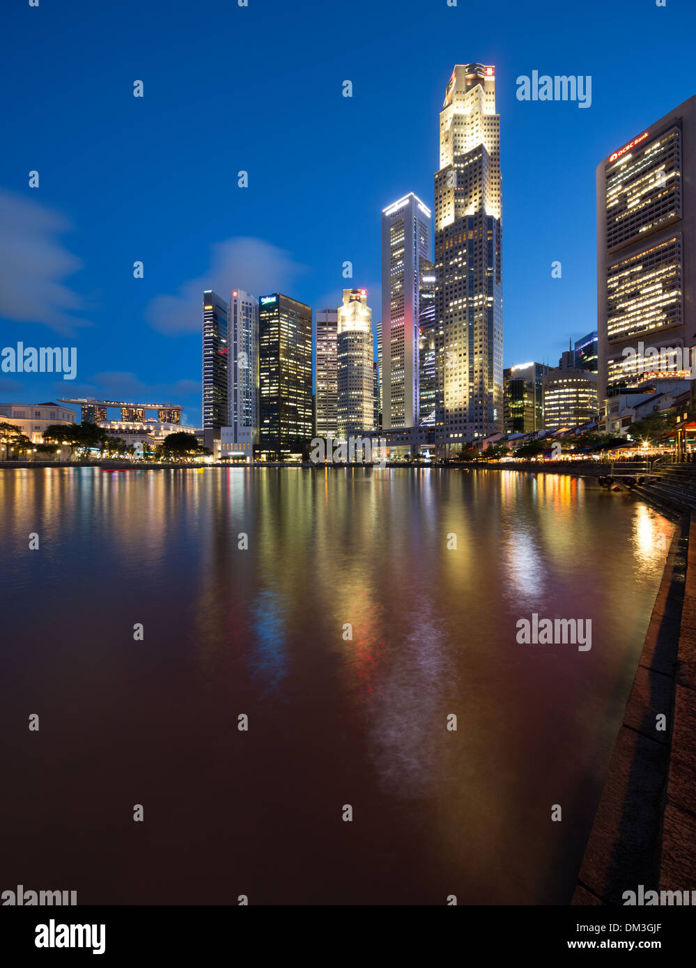 the Central Business District at night from Boat Quay, Singapore - Stock Image