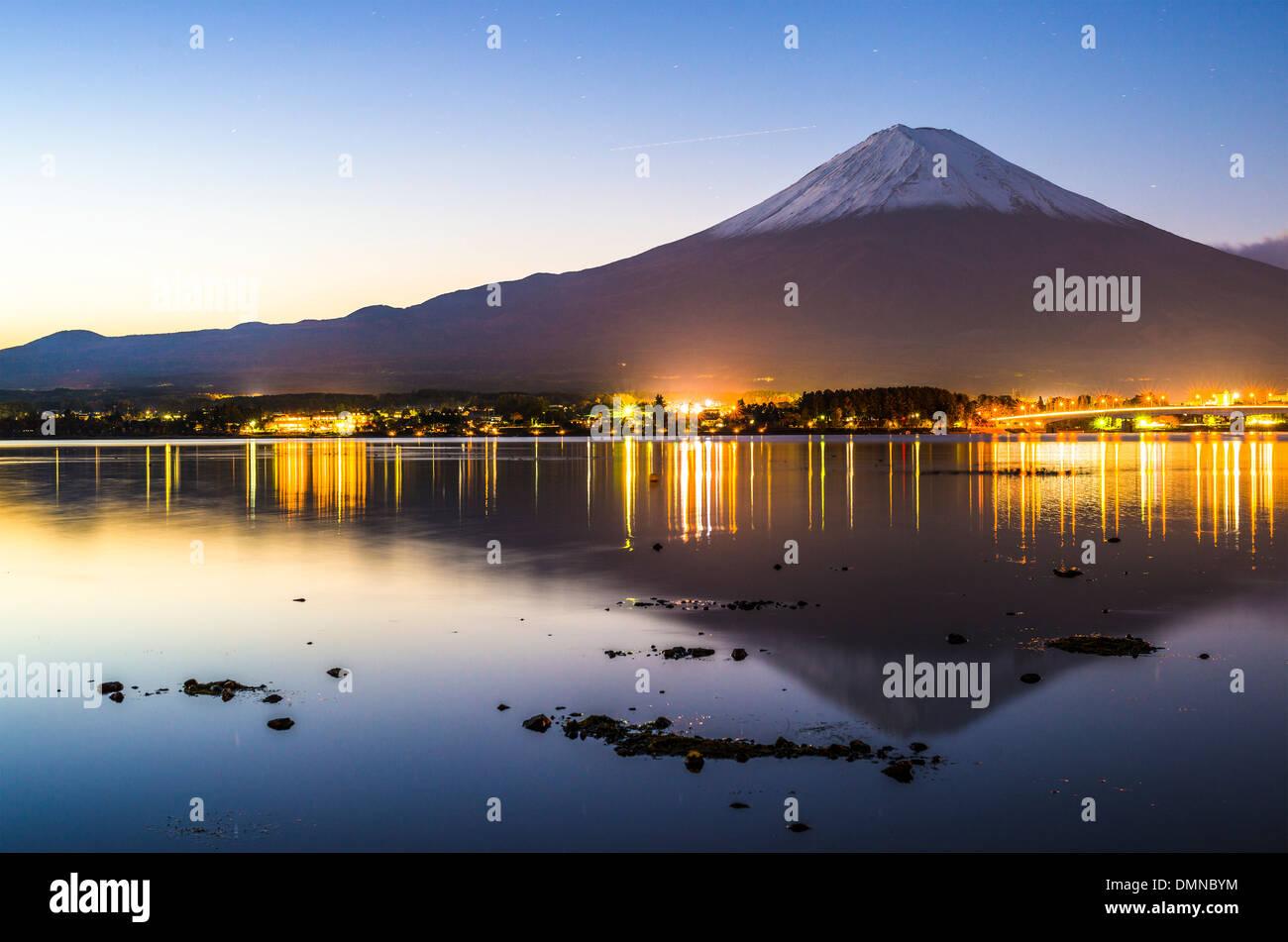 Mt. Fuji at dusk over Lake Kawaguchi in Japan. - Stock Image