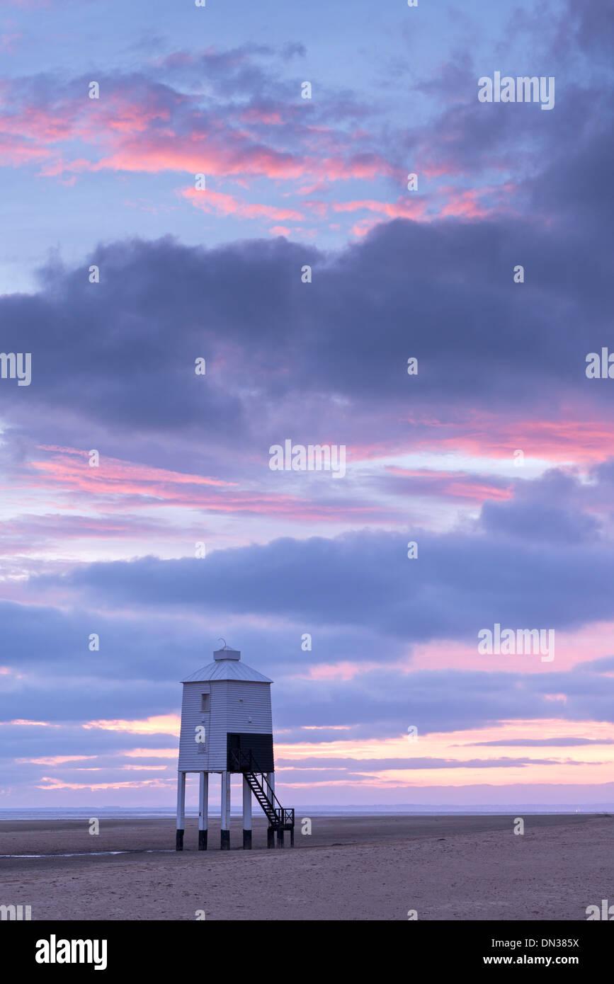 Sunset beyond wooden lighthouse at Burnham-on-Sea, Somerset, England. Autumn (September) 2013. - Stock Image
