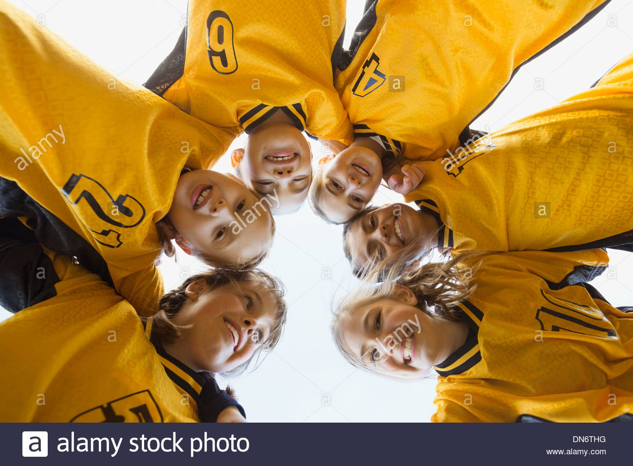 Portrait of soccer players forming huddle - Stock Image
