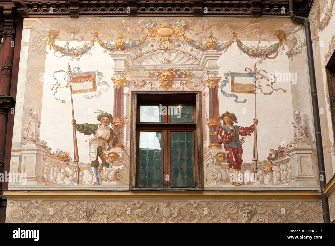 Mural and architectural detail in the courtyard of Peleș Castle in Sinaia in the Transylvania region of central - Stock Image
