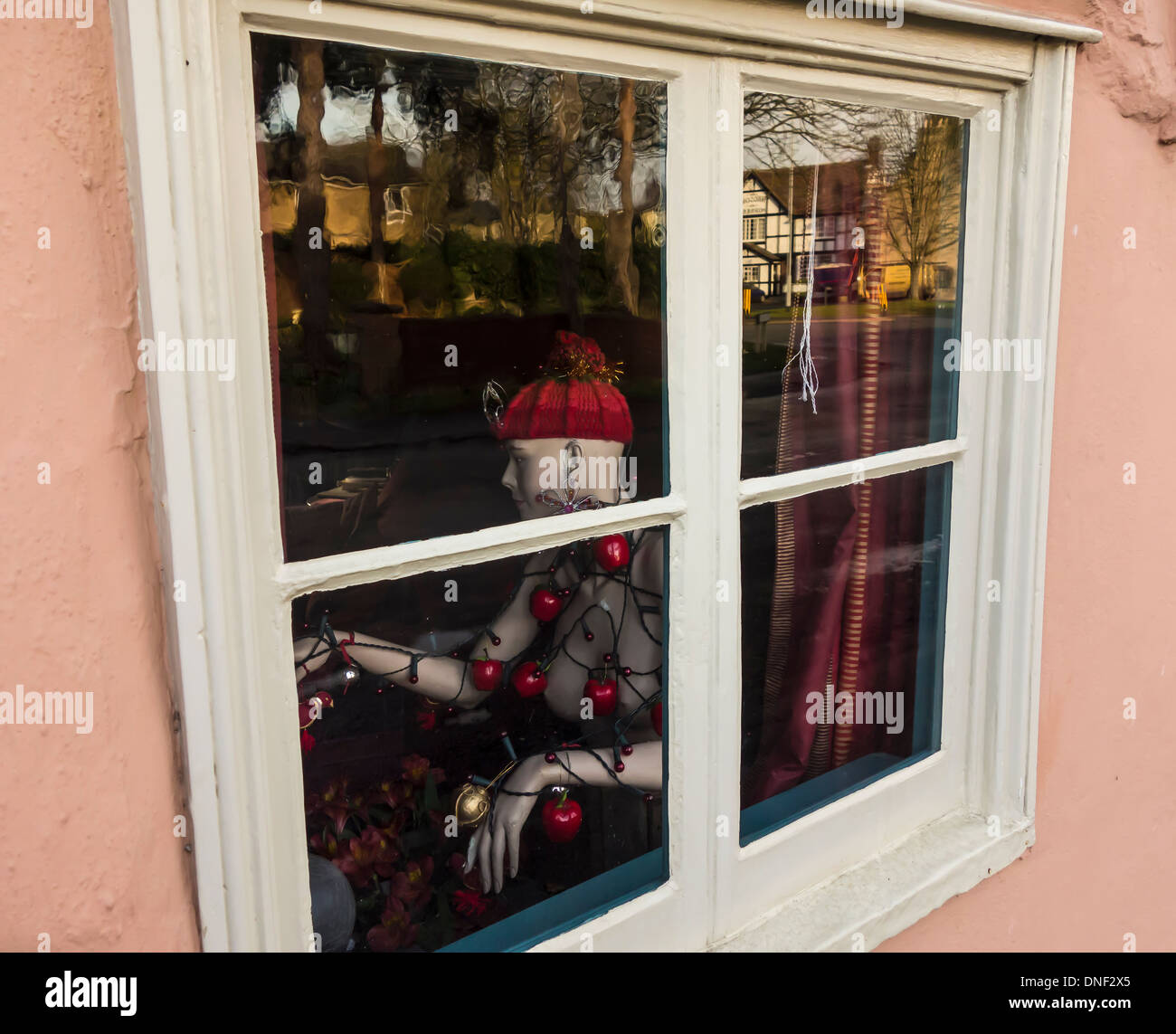 Decorated mannequin through window Stock Photo