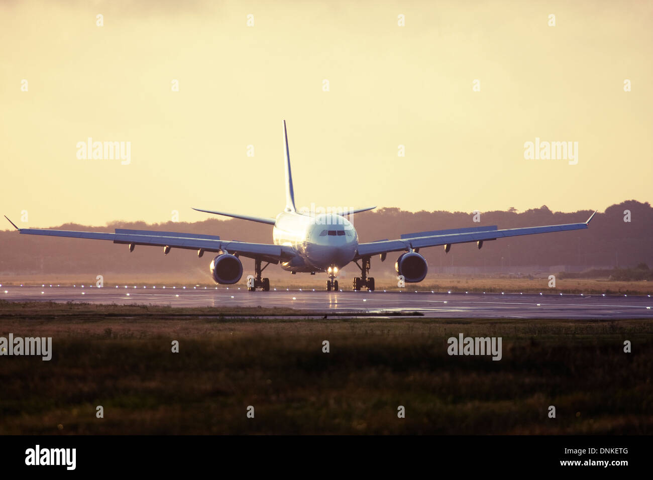 Commercial airliner at London Gatwick Airport runway, England, United Kingdom Stock Photo