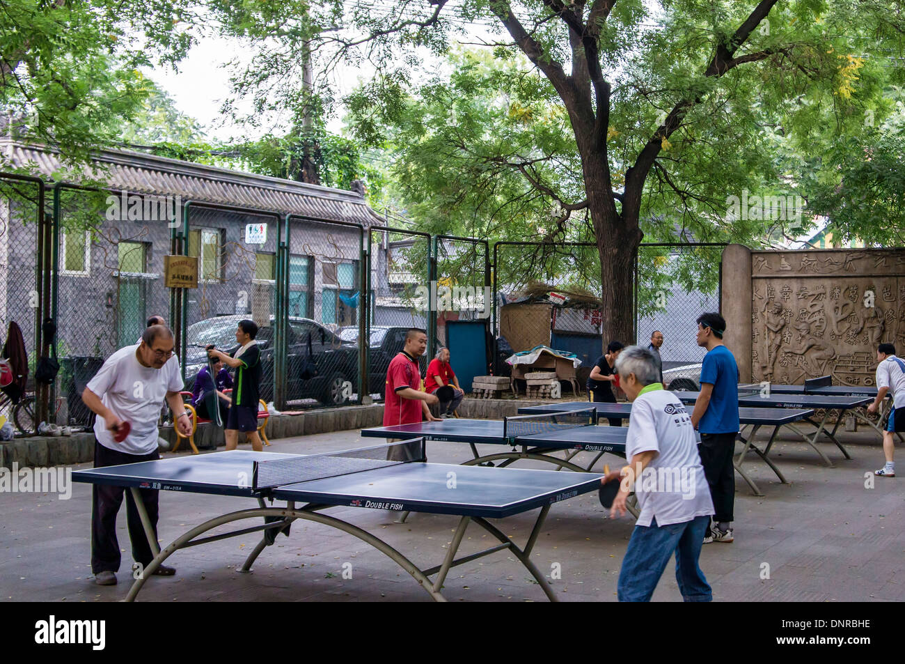 People Playing Table Tennis in a Park, Bejing, China - Stock Image