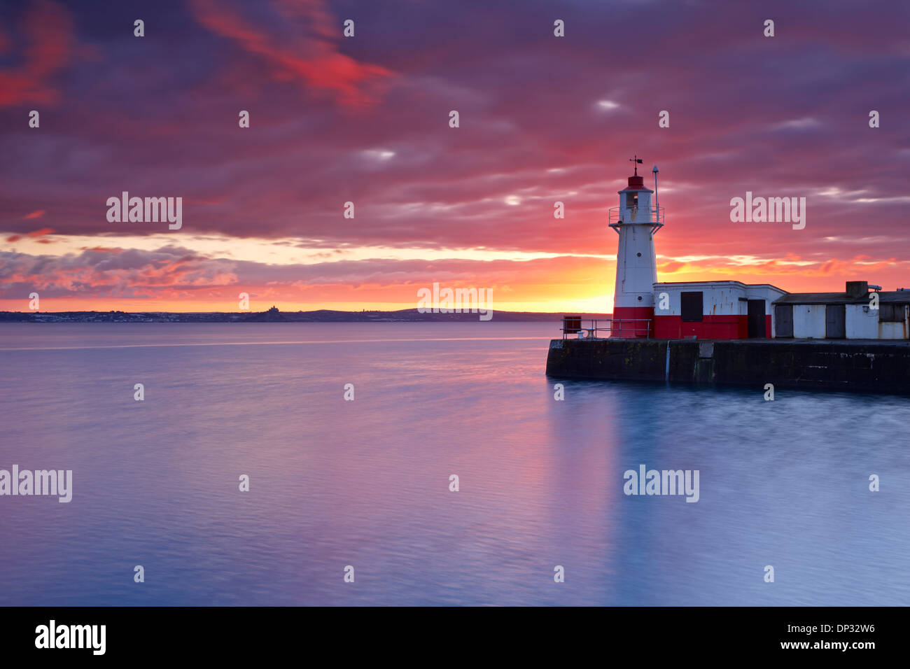 Sunrise over Newlyn Harbour Entrance and Mounts Bay - Stock Image
