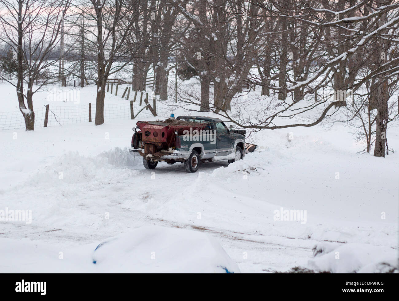 4x4-truck-with-snowplow-clearing-a-farm-