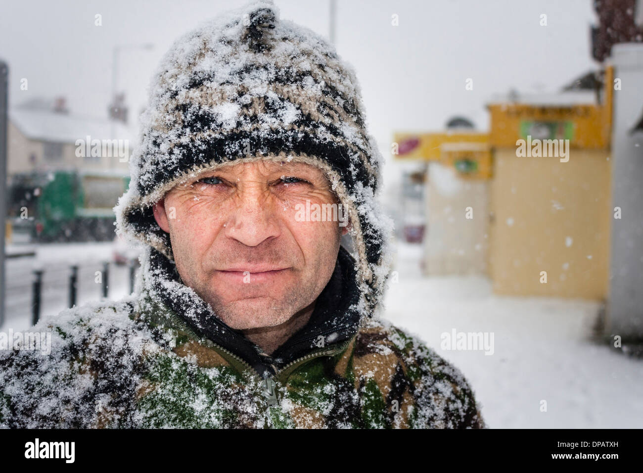 Portrait of man outside in winter snowstorm. Stock Photo