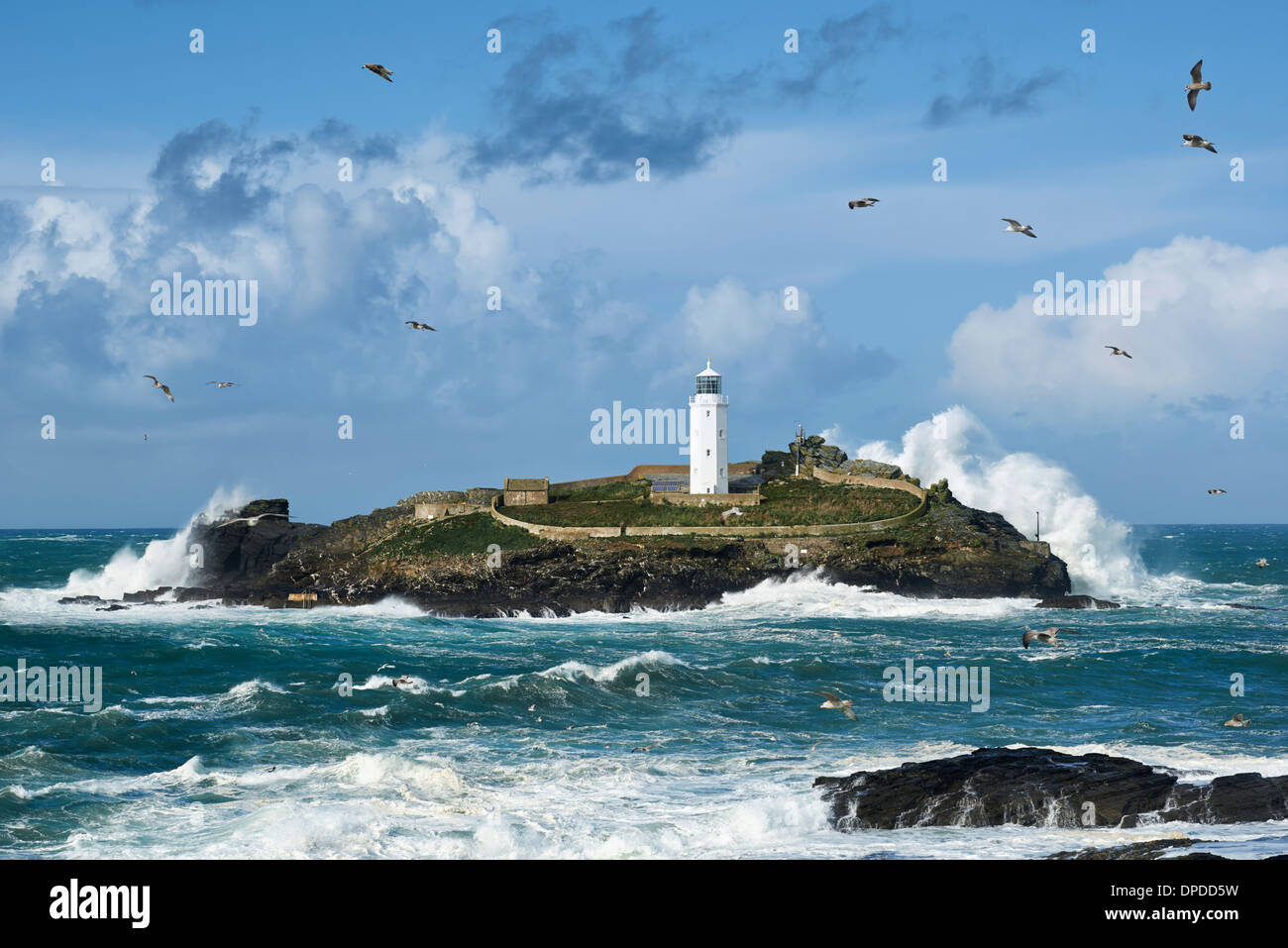 Huge waves hitting Godrevy Island in Cornwall after the storm nicknamed 'St Jude' - Stock Image