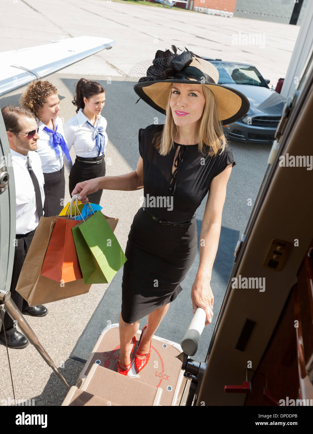 confident-woman-carrying-shopping-bags-w