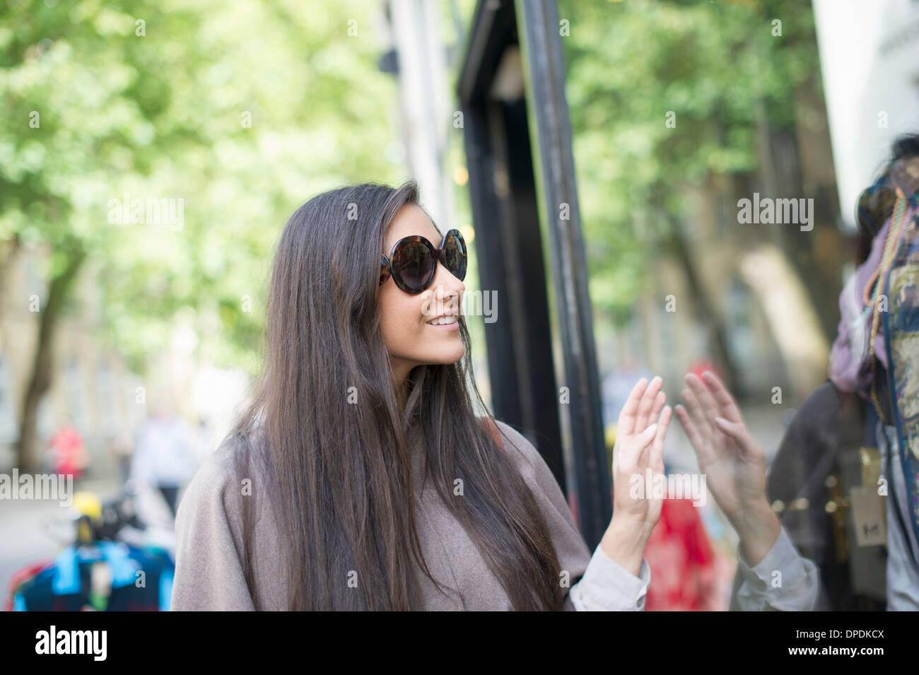 Young woman window shopping - Stock Image
