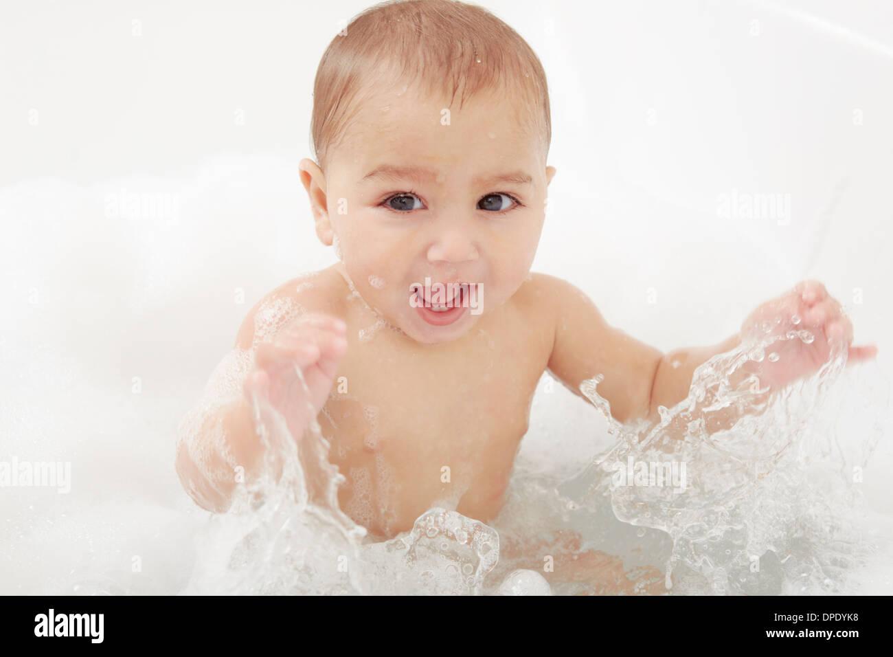 Baby splashing in bathtub Stock Photo: 65460620 - Alamy
