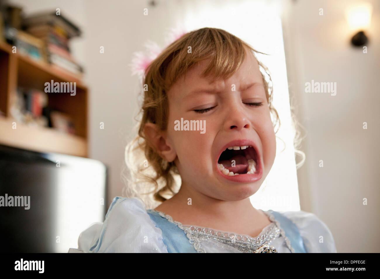 Close up of female toddler crying - Stock Image