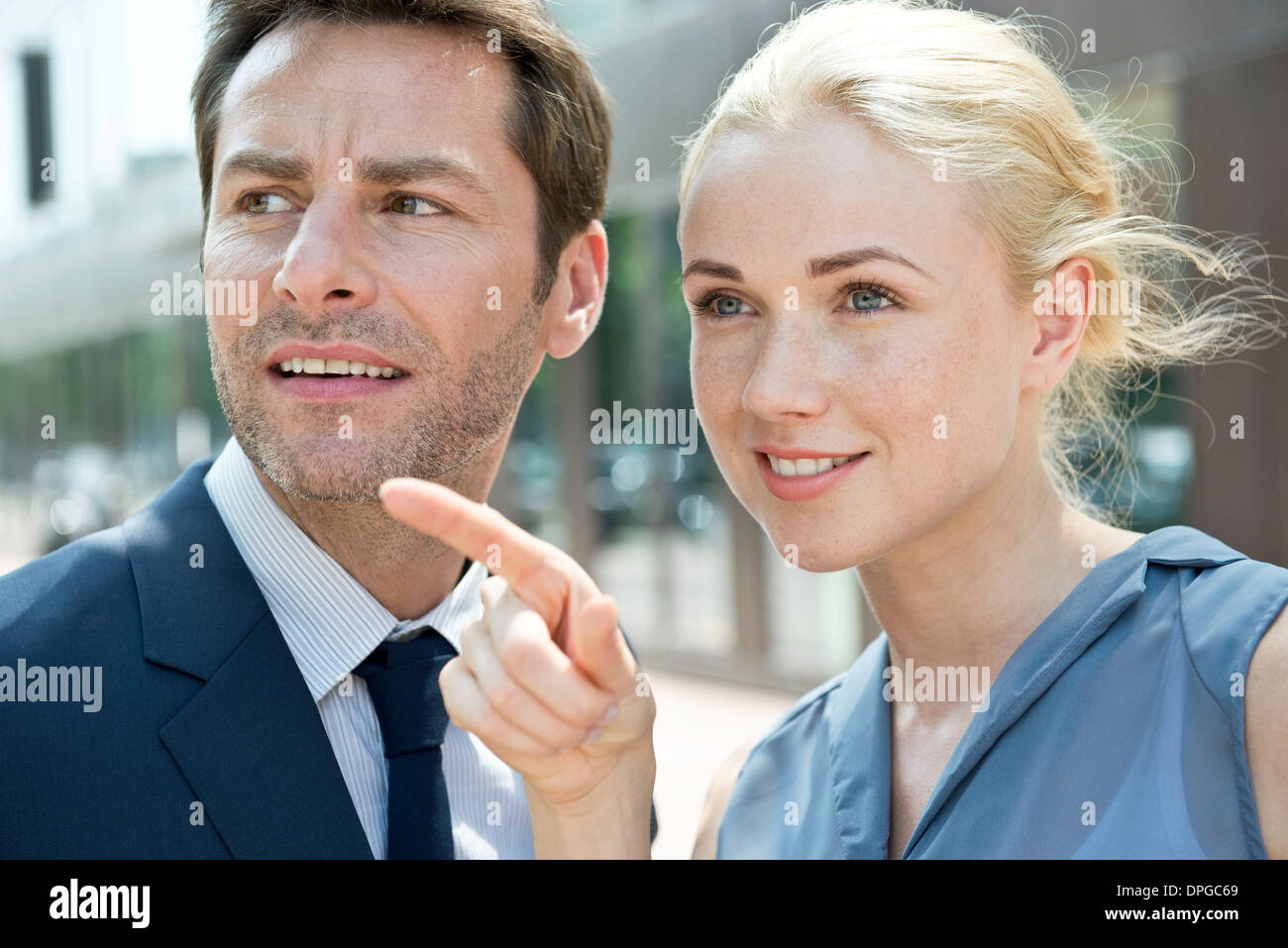 Real estate agent showing property to potential buyer - Stock Image