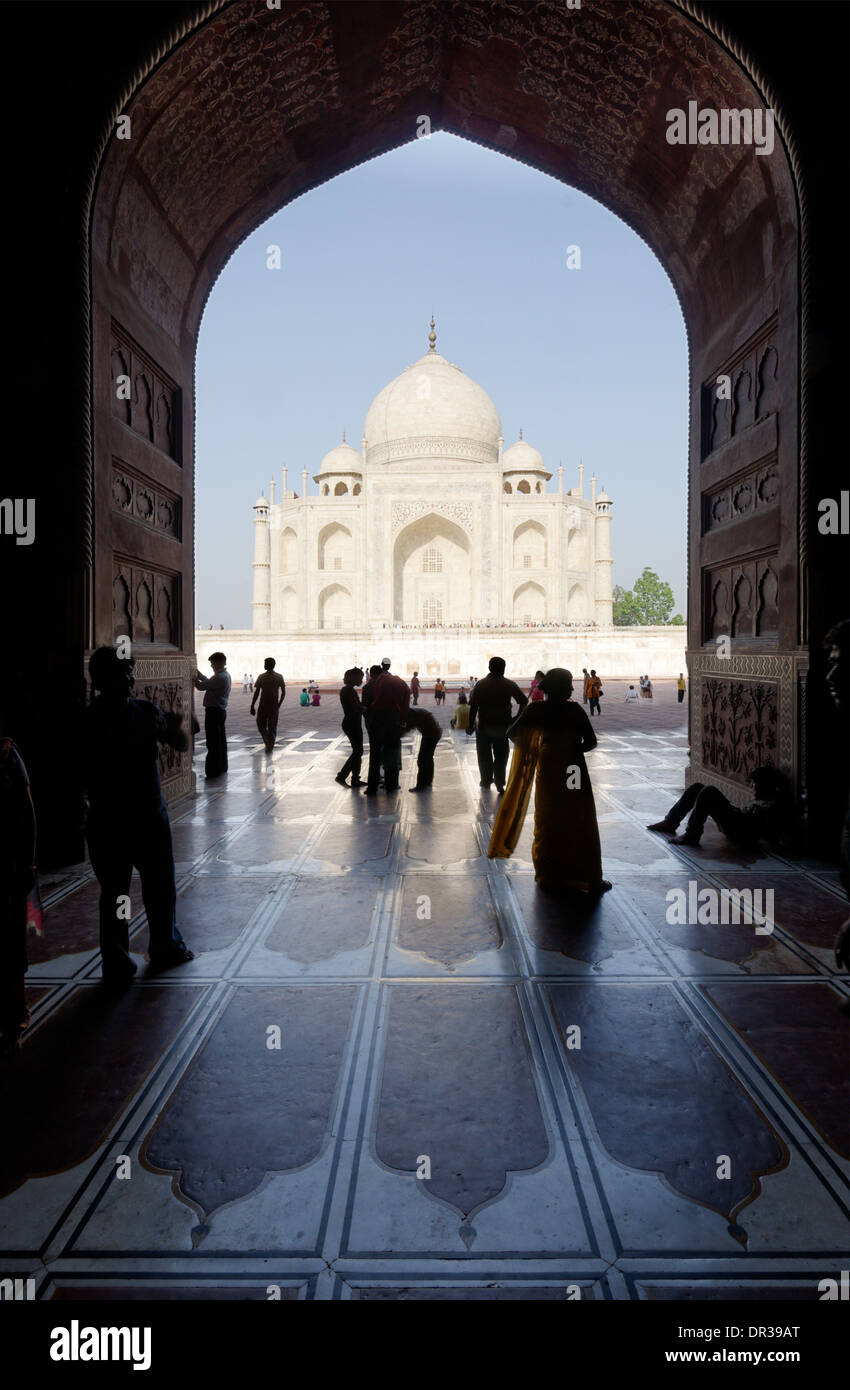 People looking through an arch at the Taj Mahal Stock Photo