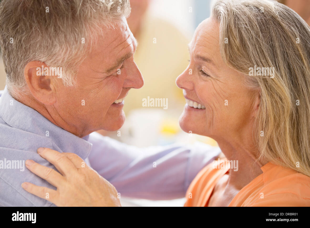 Senior couple hugging - Stock Image