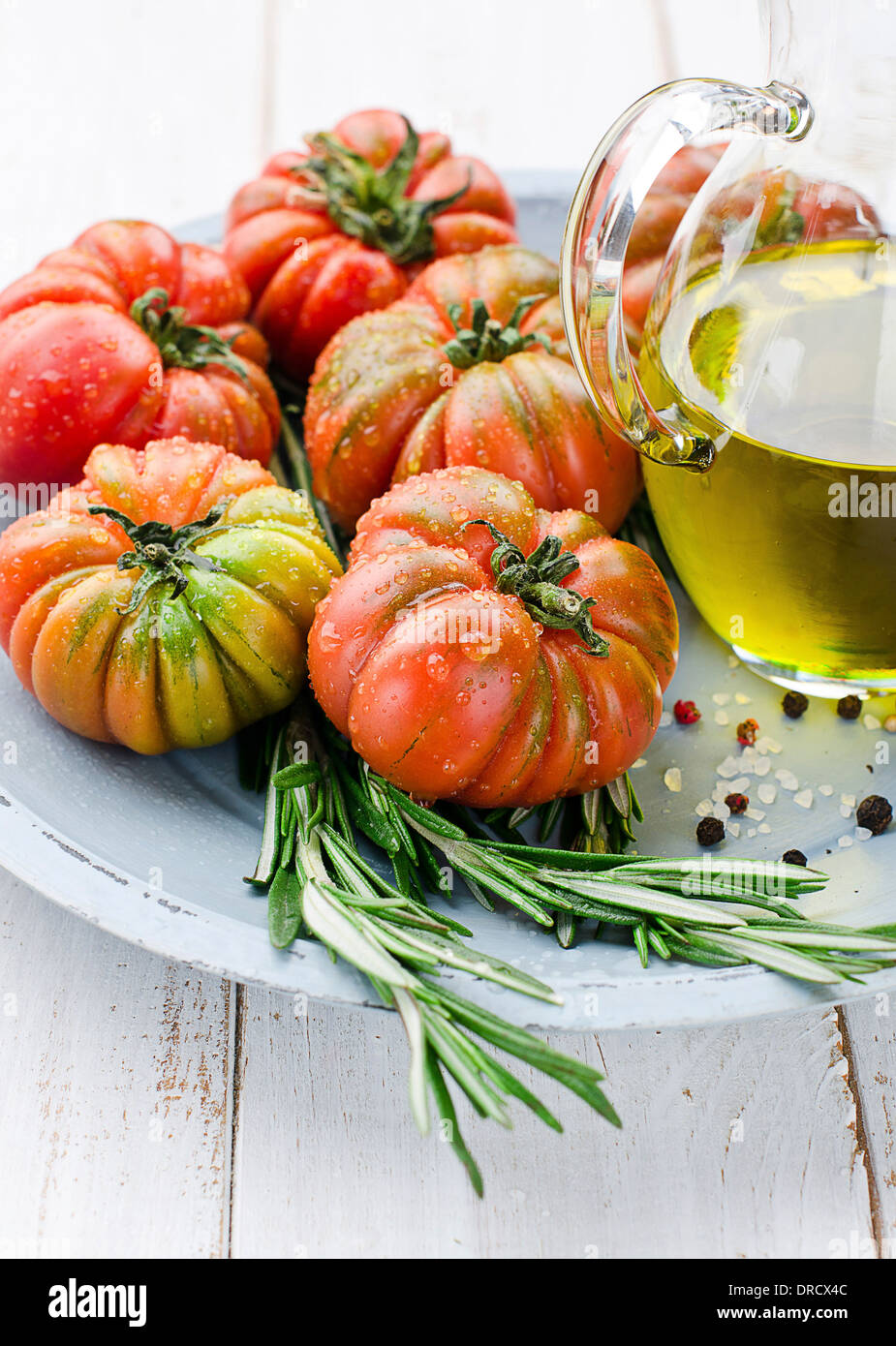Fresh tomatoes and olive oil - Stock Image