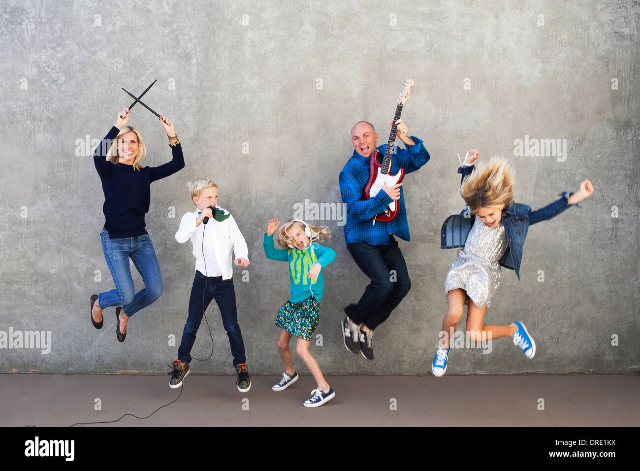 Family rocking out - Stock Image