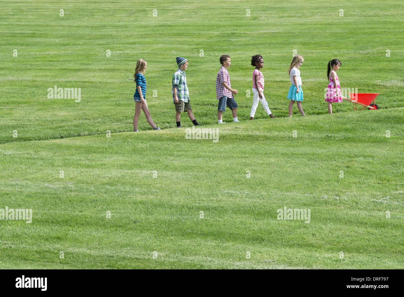 Utah USA group children walking up slope height order - Stock Image