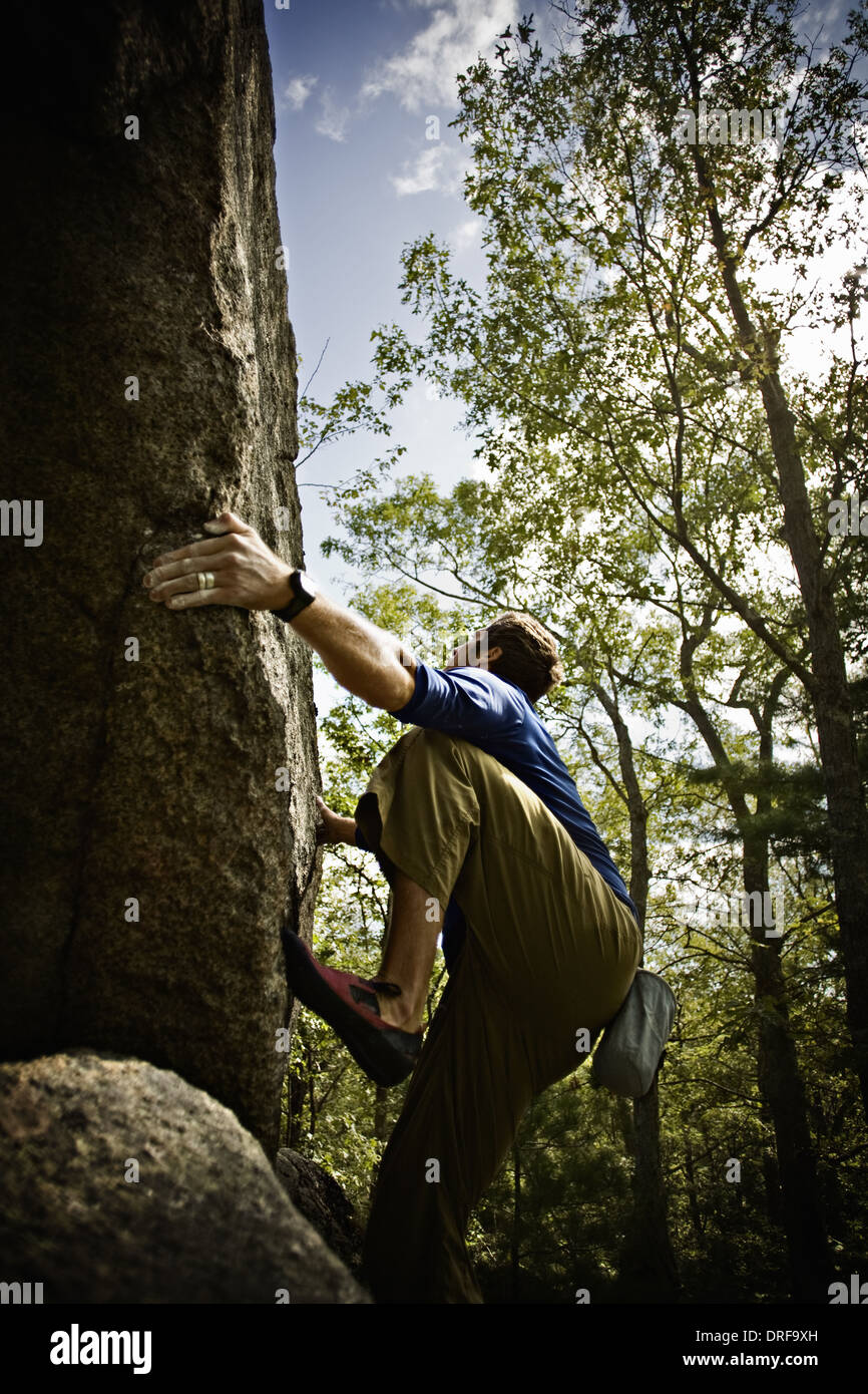 Massachusetts USA Bouldering climber free climbing steep cliffs - Stock Image