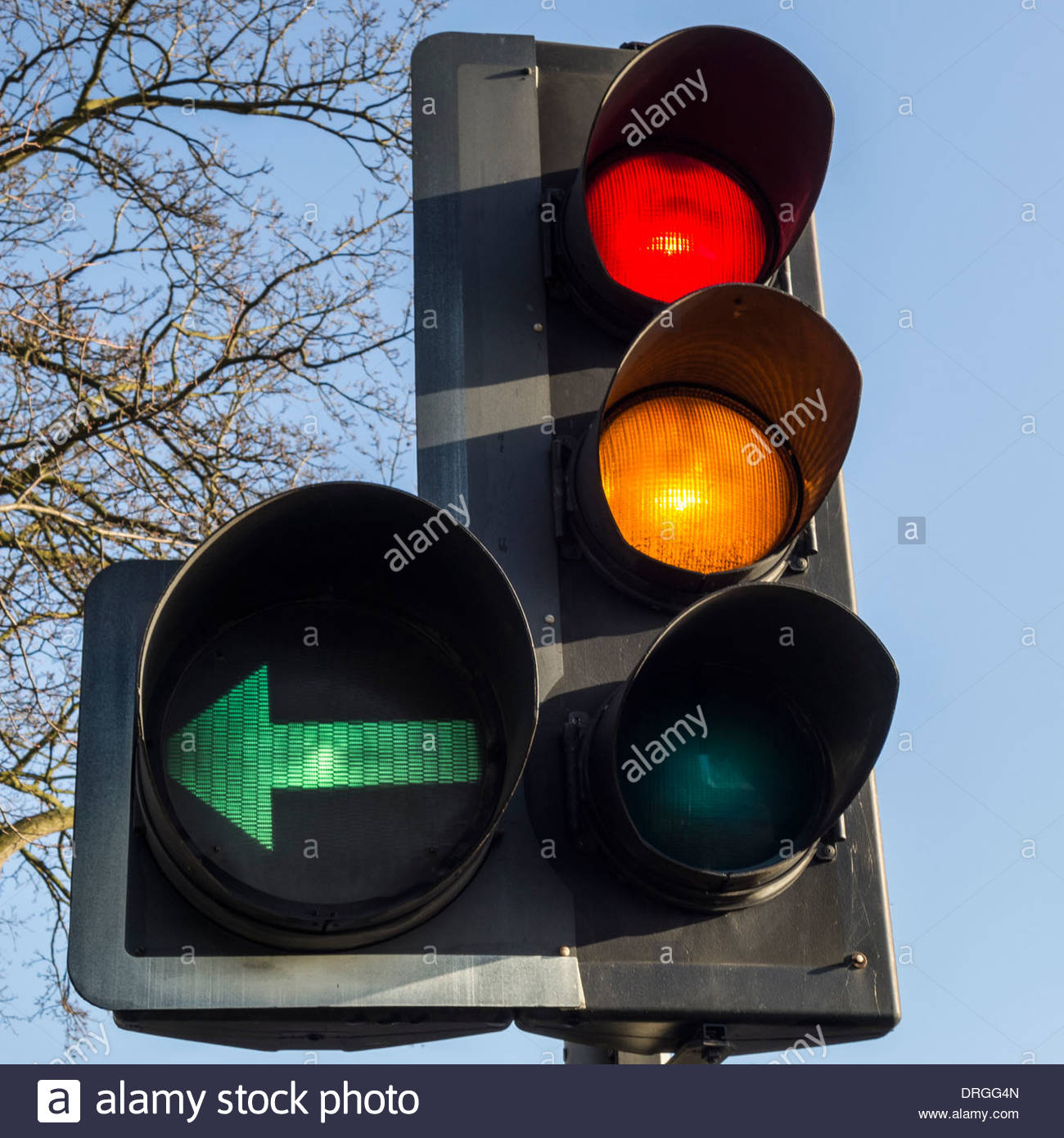Attractive Traffic Light Showing Red And Amber Forward Signal Plus A Left Green Filter Photo