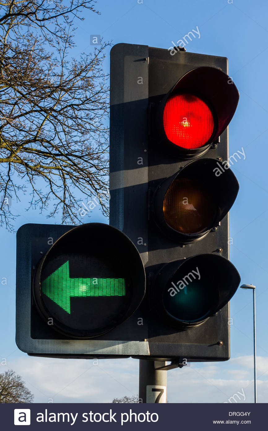 Beautiful Traffic Light Showing A Red Stop Ahead Plus A Left Green Filter
