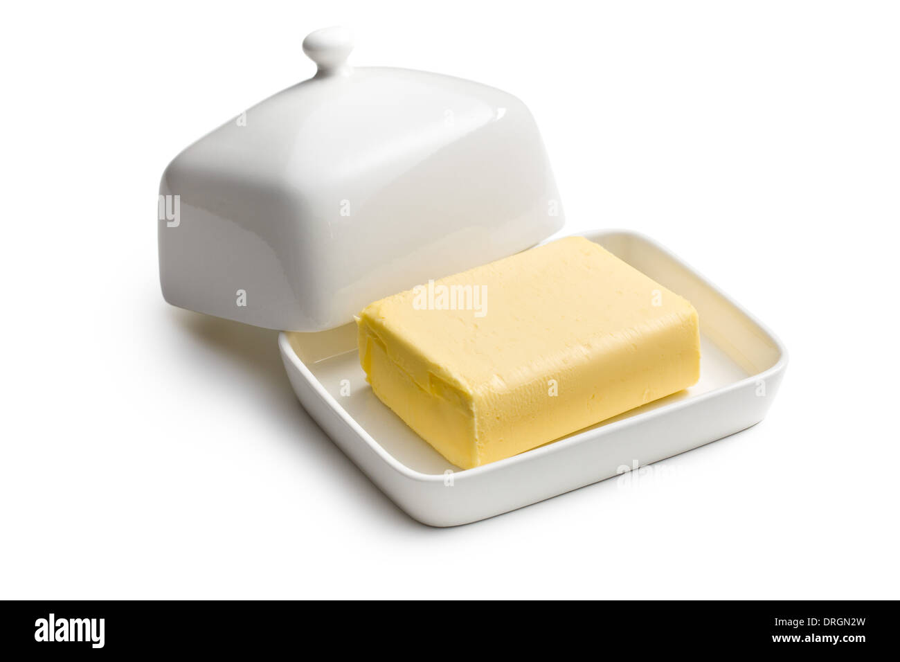 cube of butter in ceramic jar - Stock Image