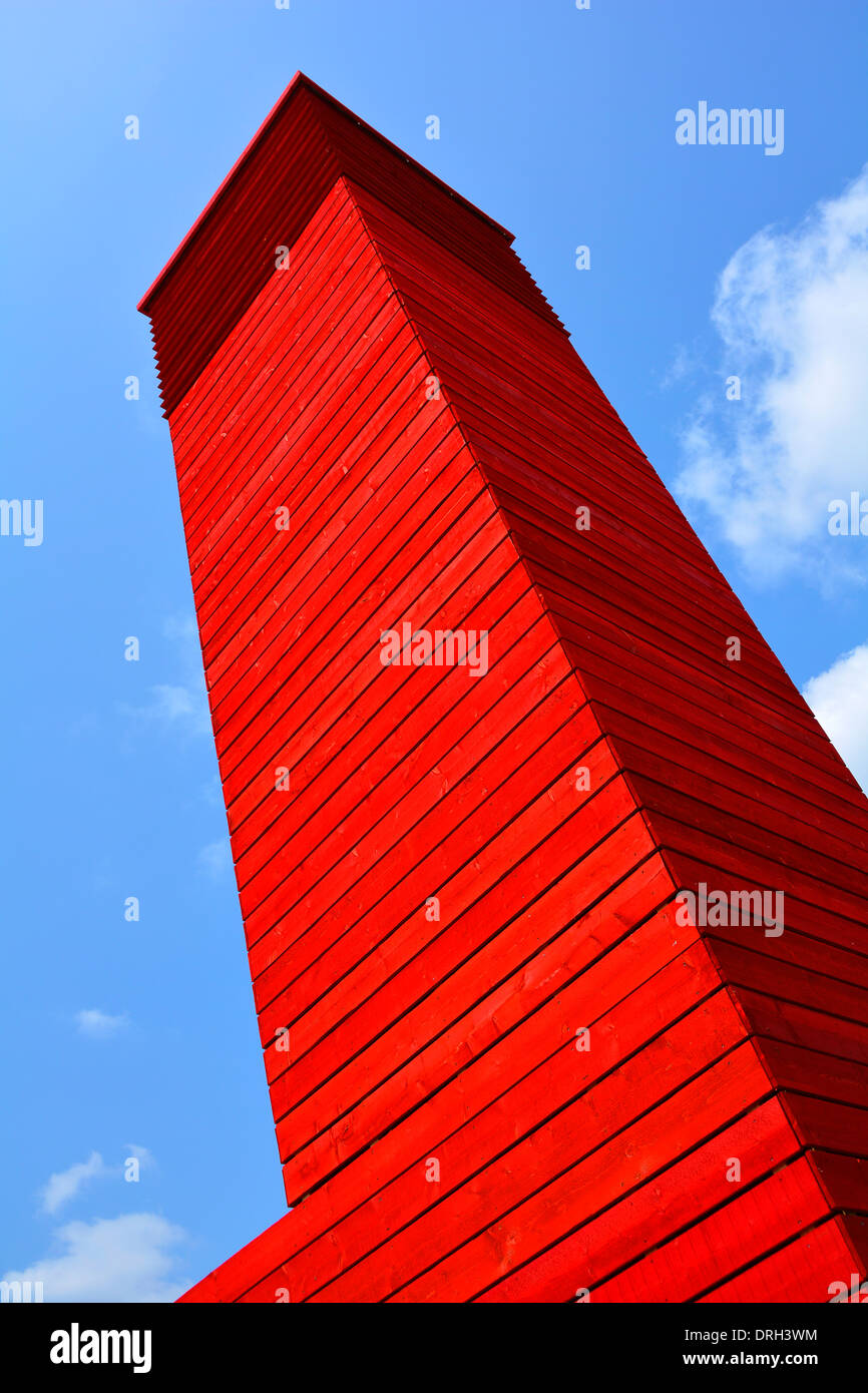 Abstract tower rising above timber building - Stock Image