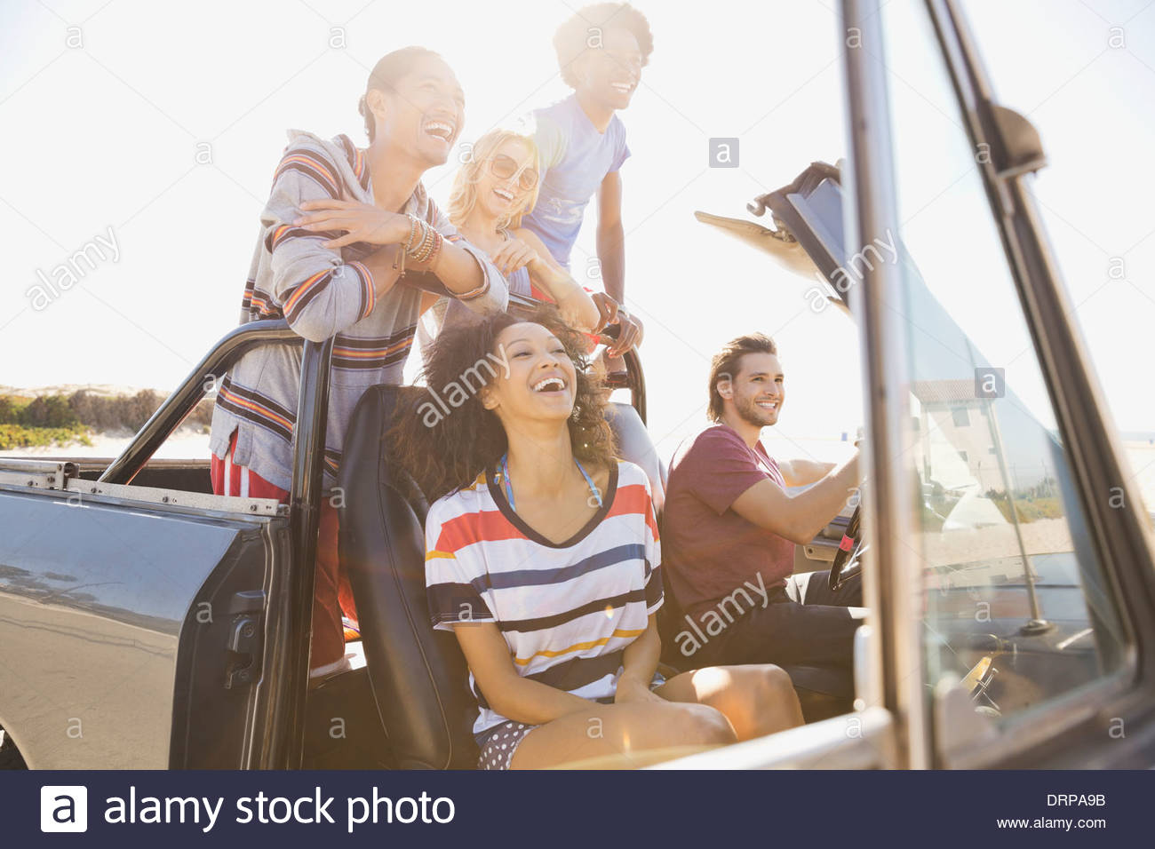 Group of friends taking a day trip to the beach - Stock Image