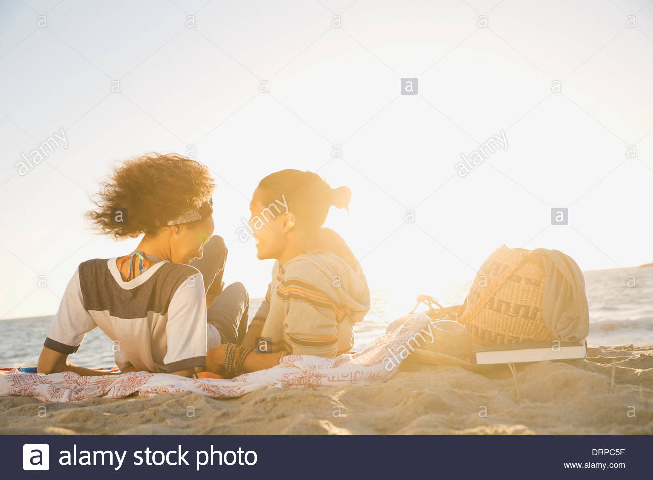 Couple spending leisure time at beach - Stock Image