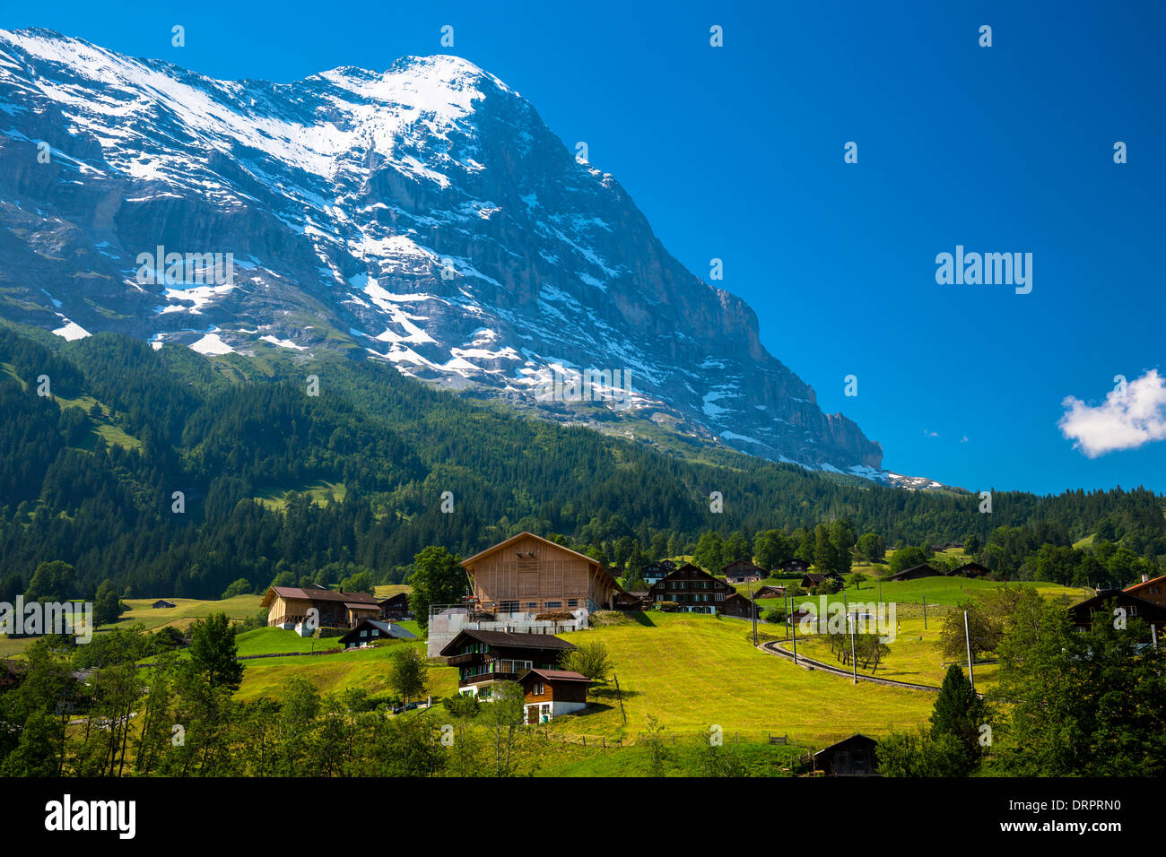 The town of grindelwald beneath the eiger mountain north face in the the town of grindelwald beneath the eiger mountain north face in the swiss alps in the bernese oberland switzerland reheart Choice Image