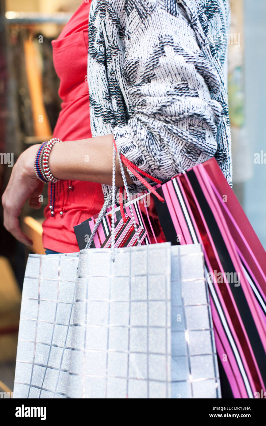 Women with shopping bags window shopping - Stock Image
