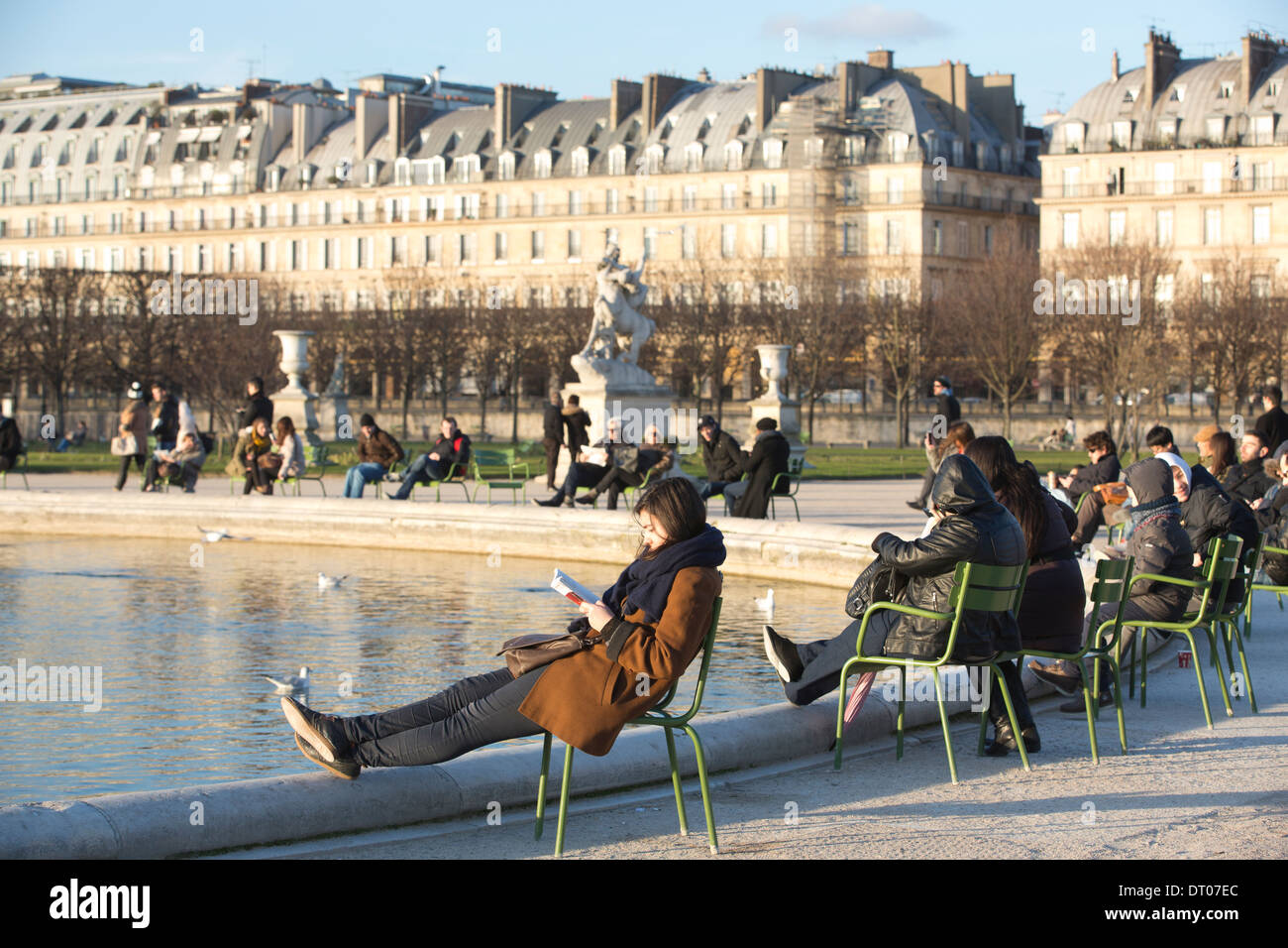 People enjoying the sun on a winters day at Jardin des Tuileries, Tuileries Gardens, Paris, France Stock Photo