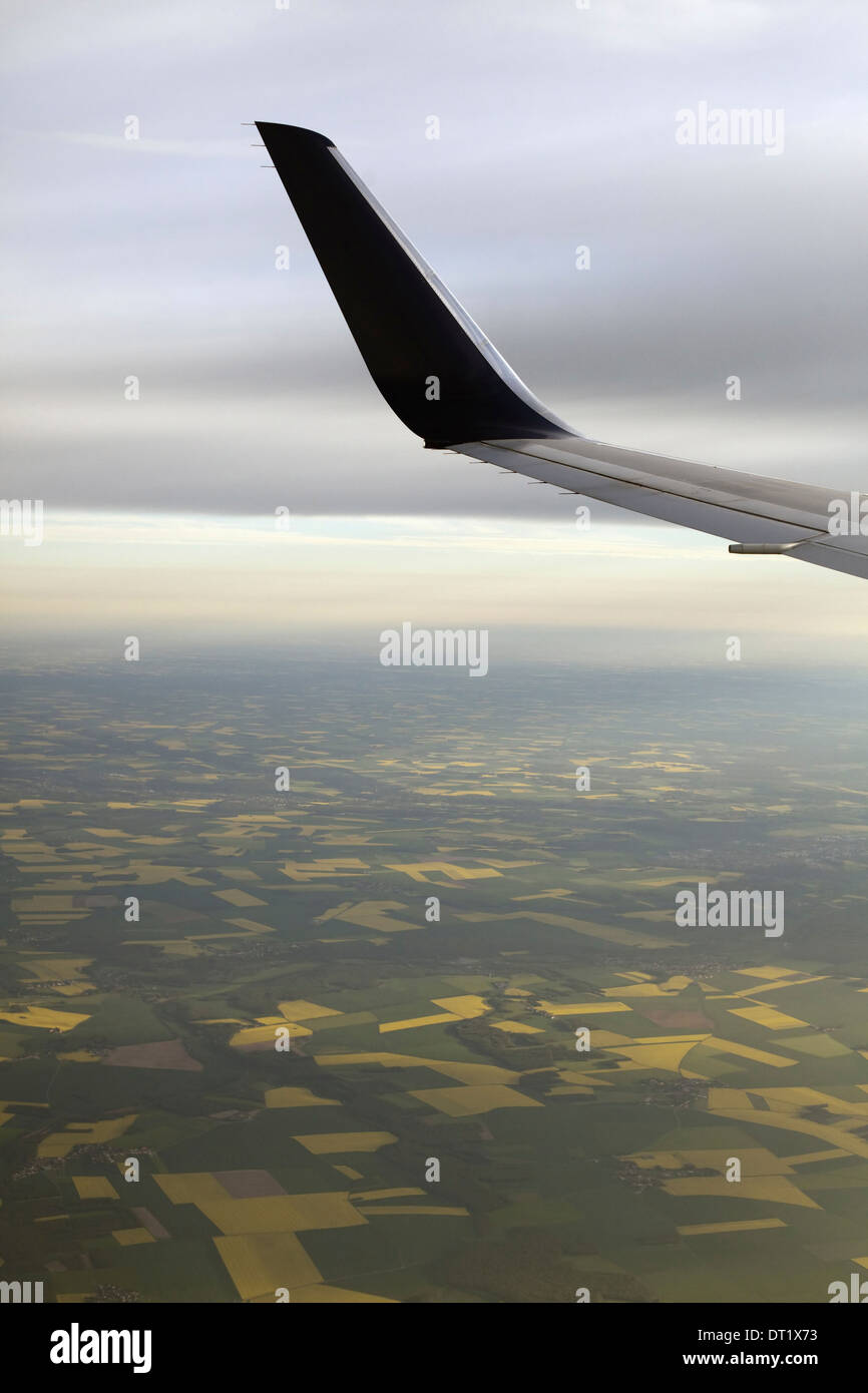 The winglet or wing tip of an aircraft viewed from the passenger window - Stock Image