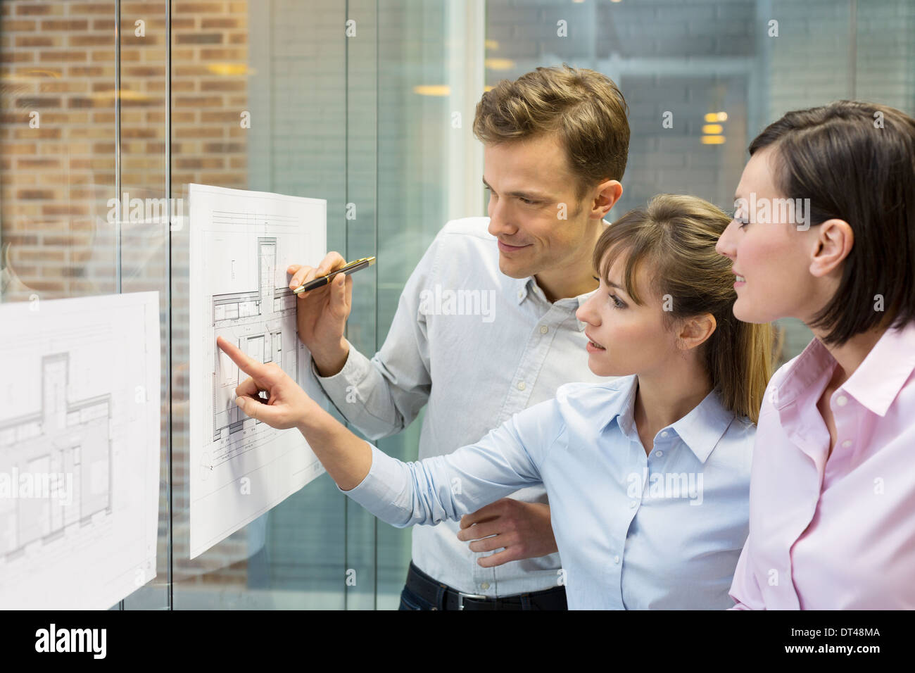 Business man woman plans meeting colleagues - Stock Image