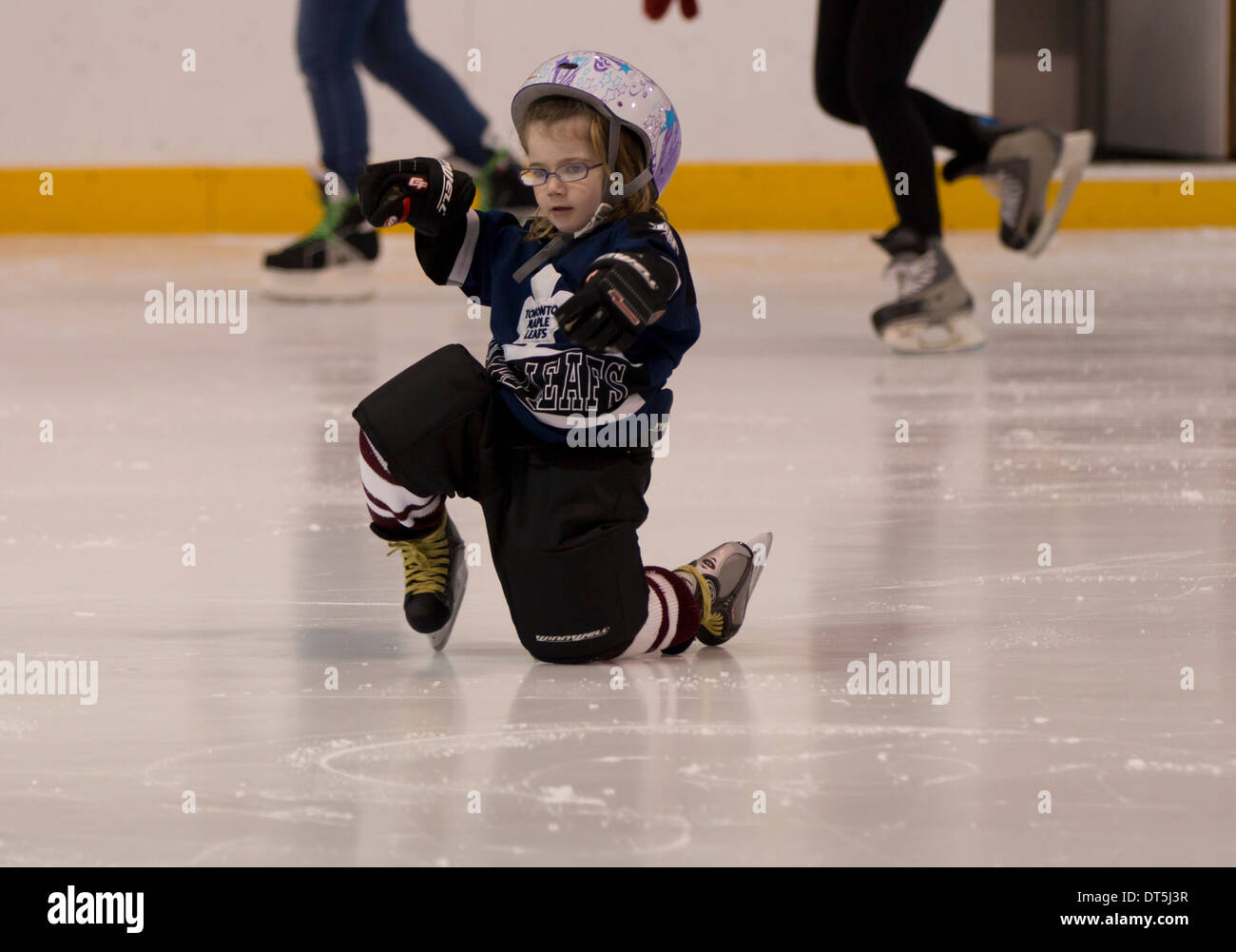 little-girl-with-glasses-getting-up-from-the-ice-wearing-toronto-maple-DT5J3R.jpg