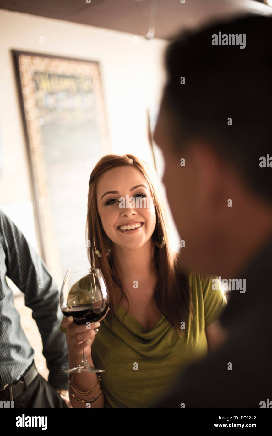 Business colleagues in wine bar - Stock Image