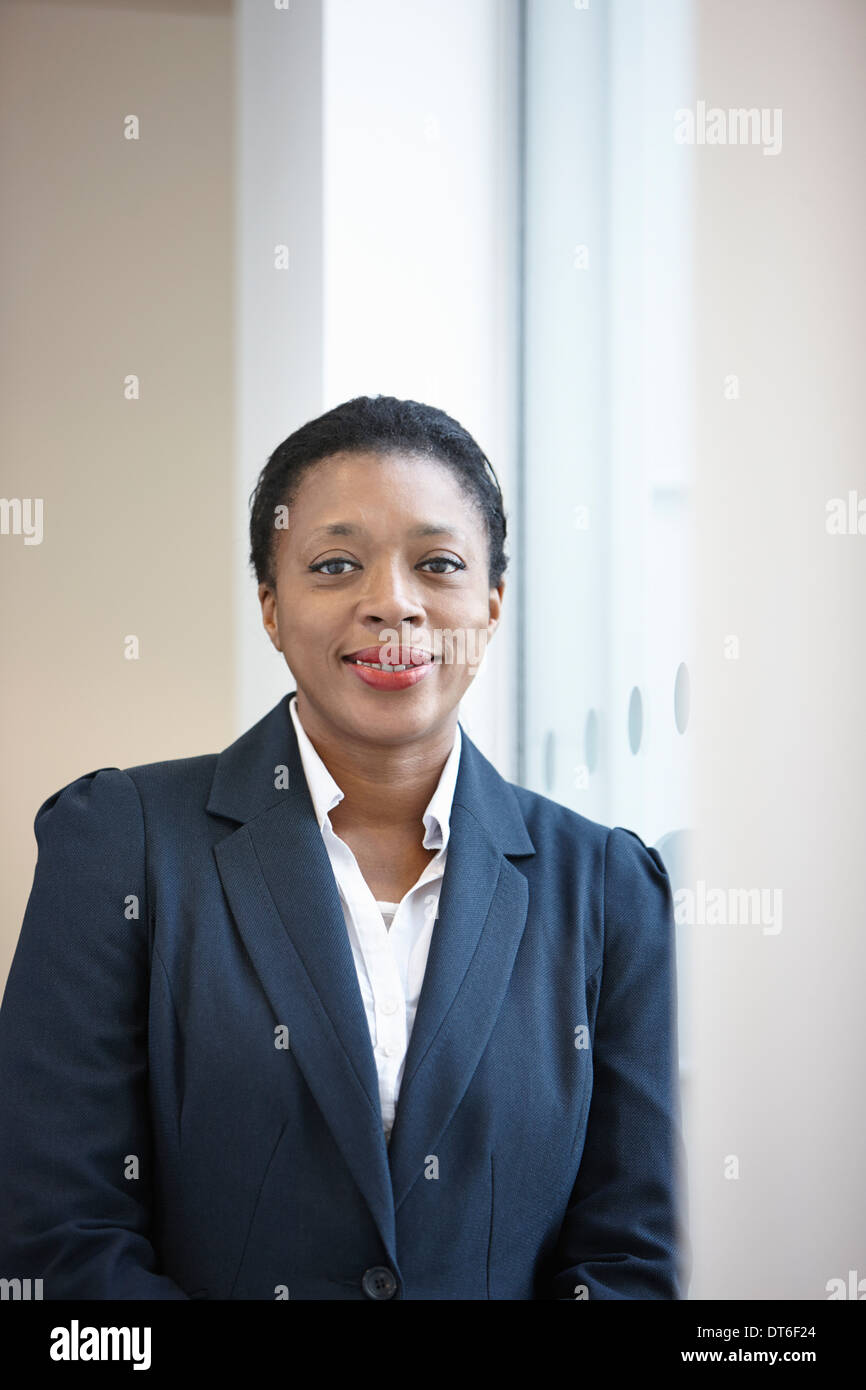 Portrait of businesswoman looking at camera - Stock Image